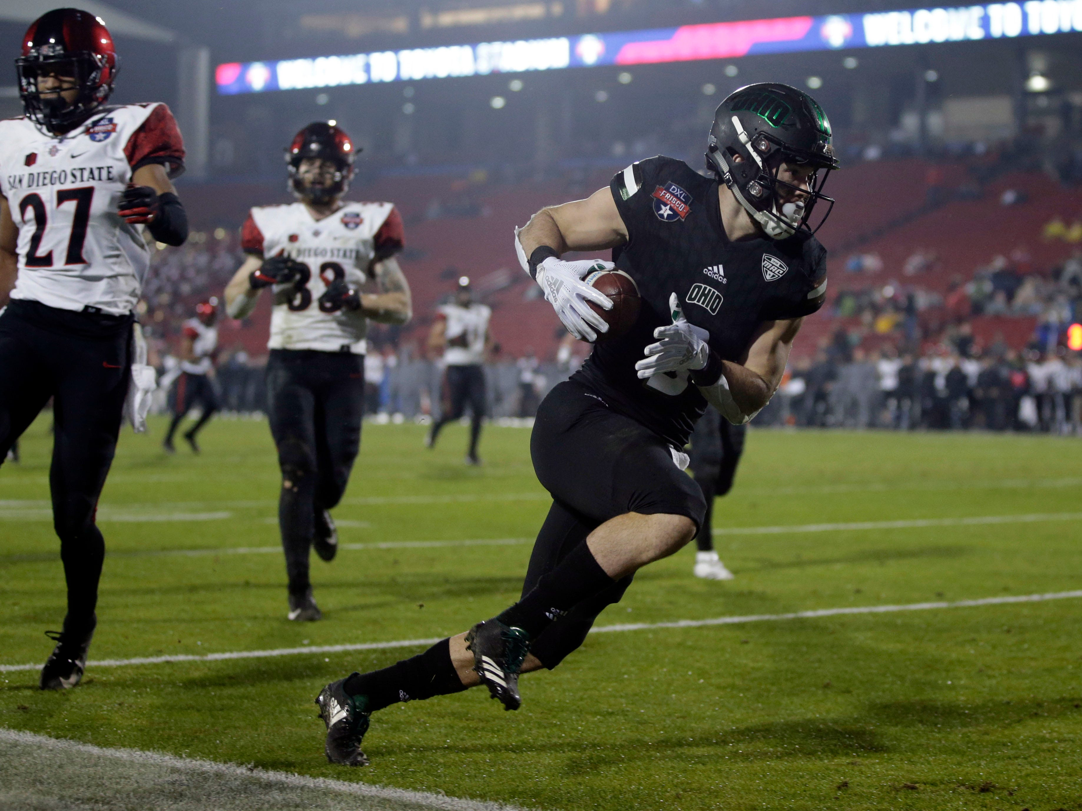 Ohio wide receiver Andrew Meyer scores a touchdown after catching a pass in the fourth quarter against San Diego State in the Frisco Bowl at Toyota Stadium.