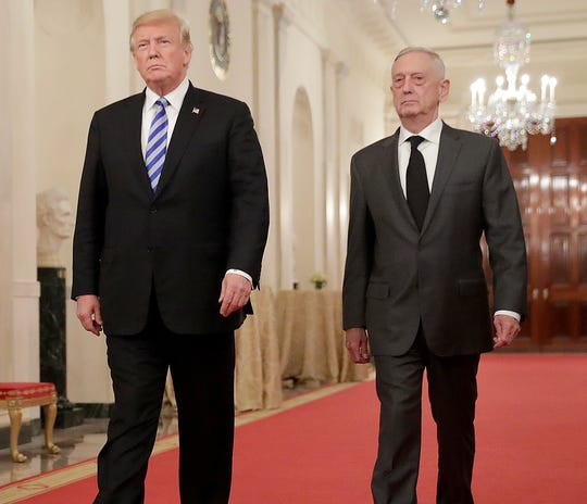 President Donald Trump and Defense Secretary Jim Mattis are pictured walking together in the White House.