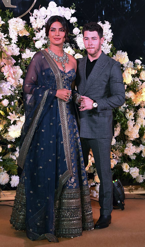 Chopra turned to Sabyasachi, the designer behind her red wedding lehenga, for her reception outfit.