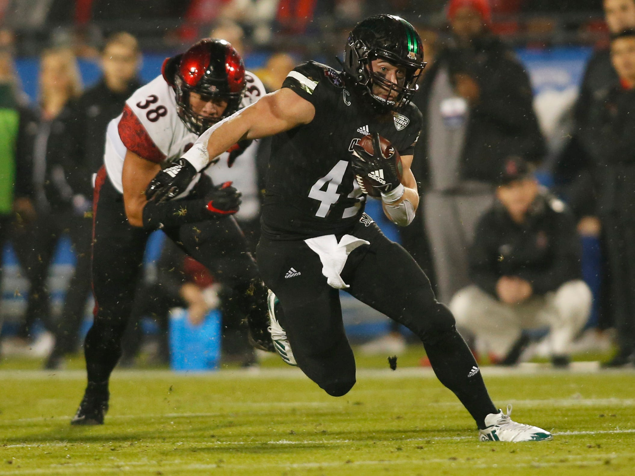 Ohio running back A.J. Ouellette (45) runs against San Diego State linebacker Andrew Aleki (38) in the first quarter in the Frisco Bowl at Toyota Stadium.