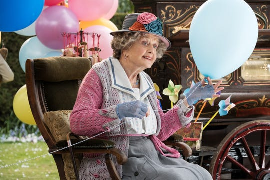 "Angela Lansbury flies as the Balloon Lady in Disney's ""Mary Poppins Returns."""