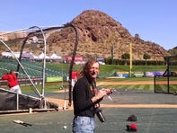 Lawr Michaels is in his element before a spring training game in Tempe, Ariz.