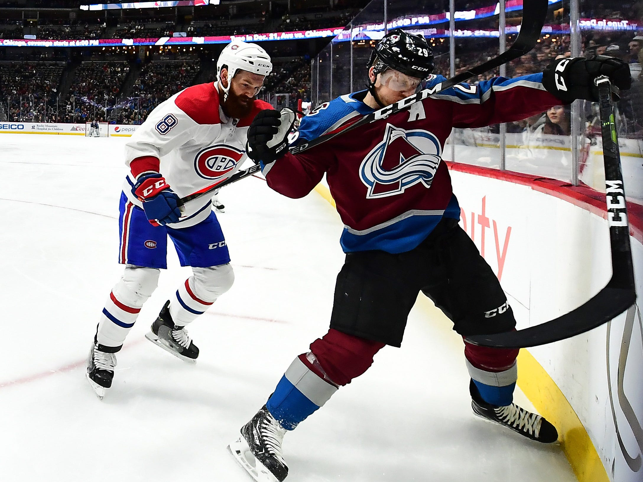 Dec. 19: Montreal Canadiens defenseman Jordie Benn (8) high sticks Colorado Avalanche center Nathan MacKinnon in the second period at the Pepsi Center. The Avalanche won the game, 2-1.