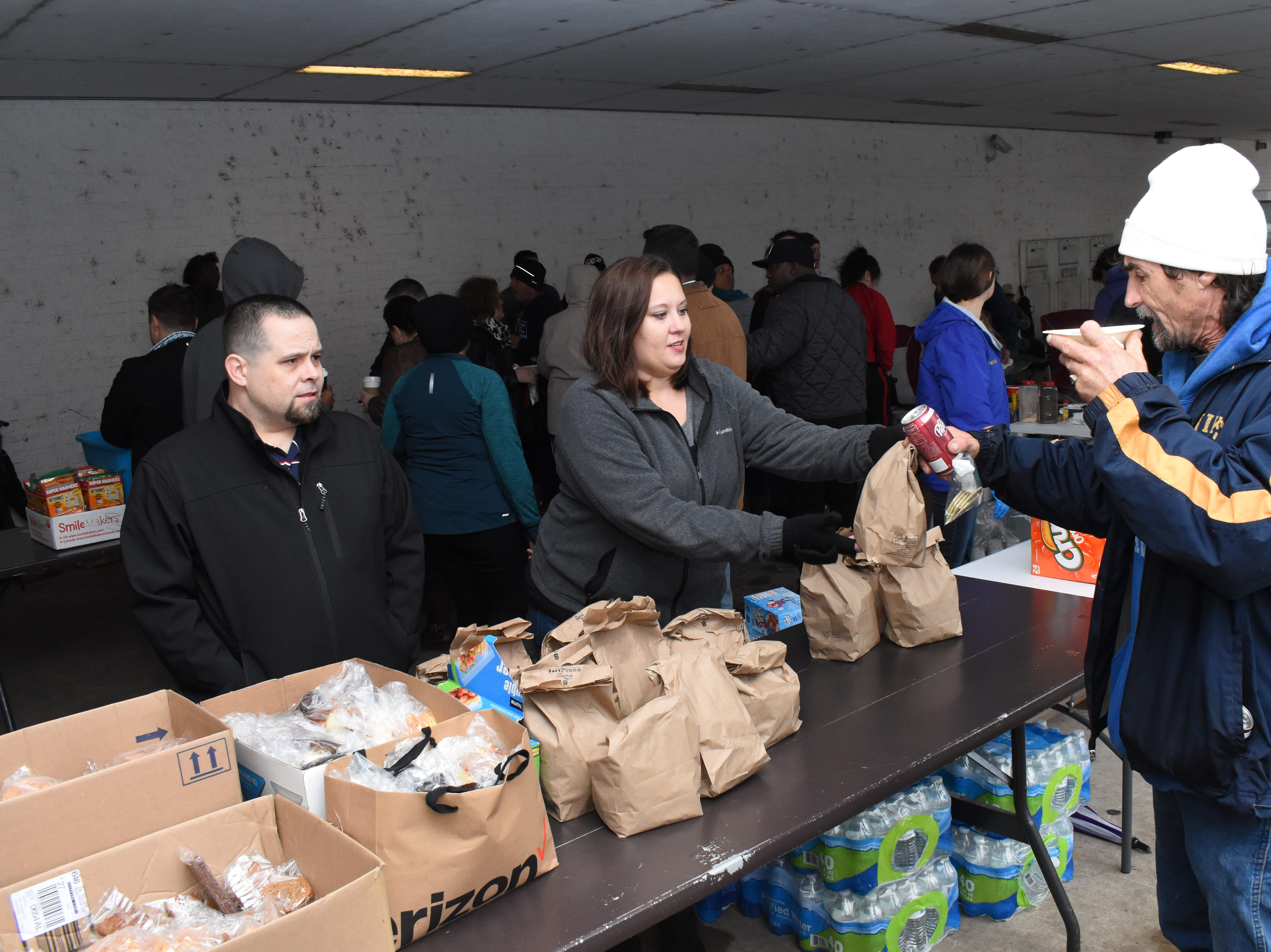 The Rapides Parish Healthy Initiatives Coalition held a gumbo luncheon for those in need Thursday, Dec. 20, 2018 in downtown Alexandria on the corner of Fourth and Desoto Streets in the car port belonging to Kinetix Solutions. Diane Tracy is the chair for the Rapides Parish Healthy Initiatives Coalition. They were expecting to feed about 200 people. In addition to gumbo, about 200 bagged lunches were provided along with extra items such as socks, hand warmers and blankets. Donating items and helping out were Antoon Hospitality Group; Amie Starks; Kitty Wynn; Central Louisiana Children's Cabinet; Pam Carey; Jennifer Gilchrist; Grace House; Esler Pentecostal pre-teen class; University Academy students; Bertha Smith with Project Success; LaTessa Mathews; We Care Behavioral Health and a number of other volunteers.