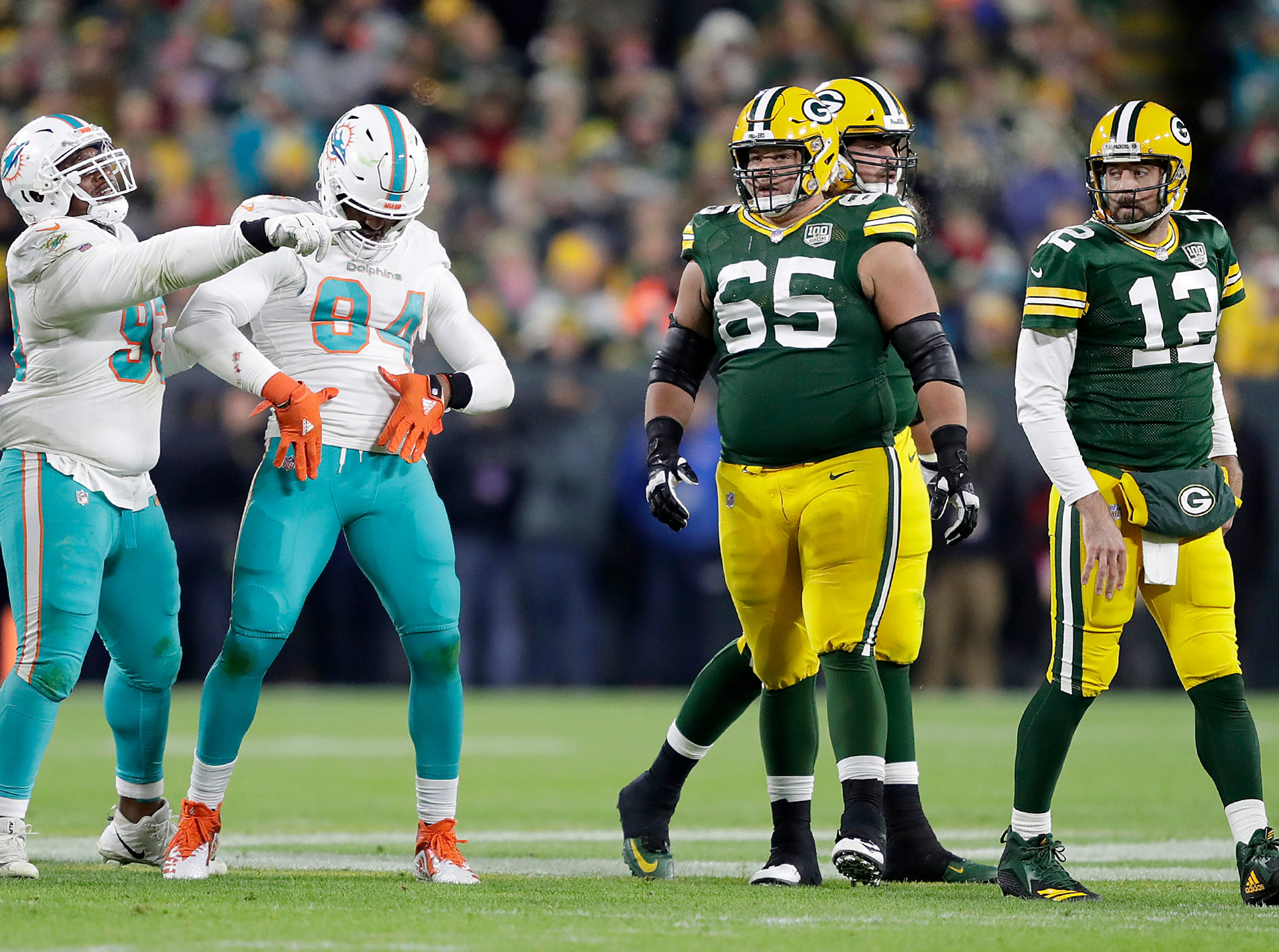 Miami Dolphins defensive end Robert Quinn celebrates after sacking Green Bay Packers quarterback Aaron Rodgers during their football game on Sunday, November 11, 2018, at Lambeau Field in Green Bay, Wis.