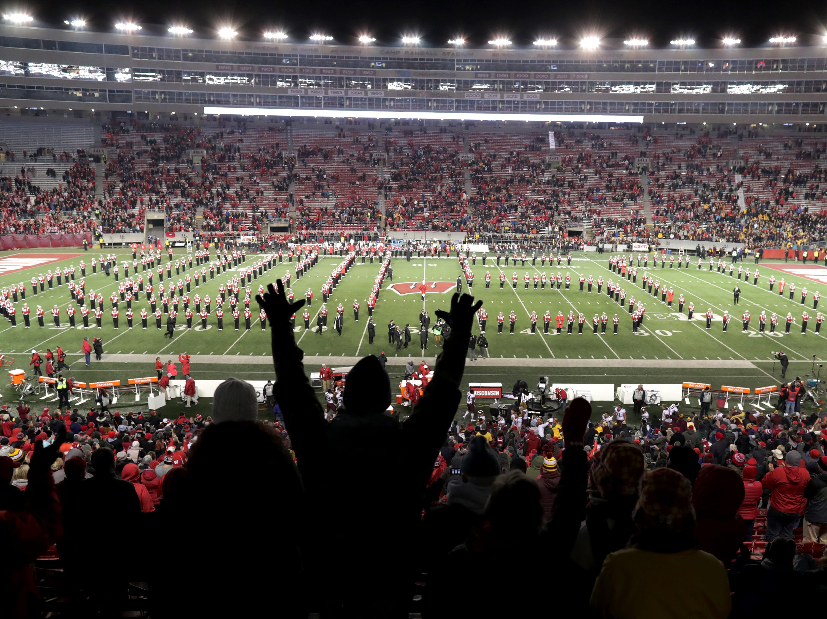 The University of Wisconsin Marching Band pays tribute to Director Michael Leckrone during the Fifth Quarter following the Wisconsin Badgers loss to the Minnesota Gophers on Saturday, November 24, 2018, at Camp Randall in Madison, Wis. Leckrone is retiring after fifty years as leader of the band.