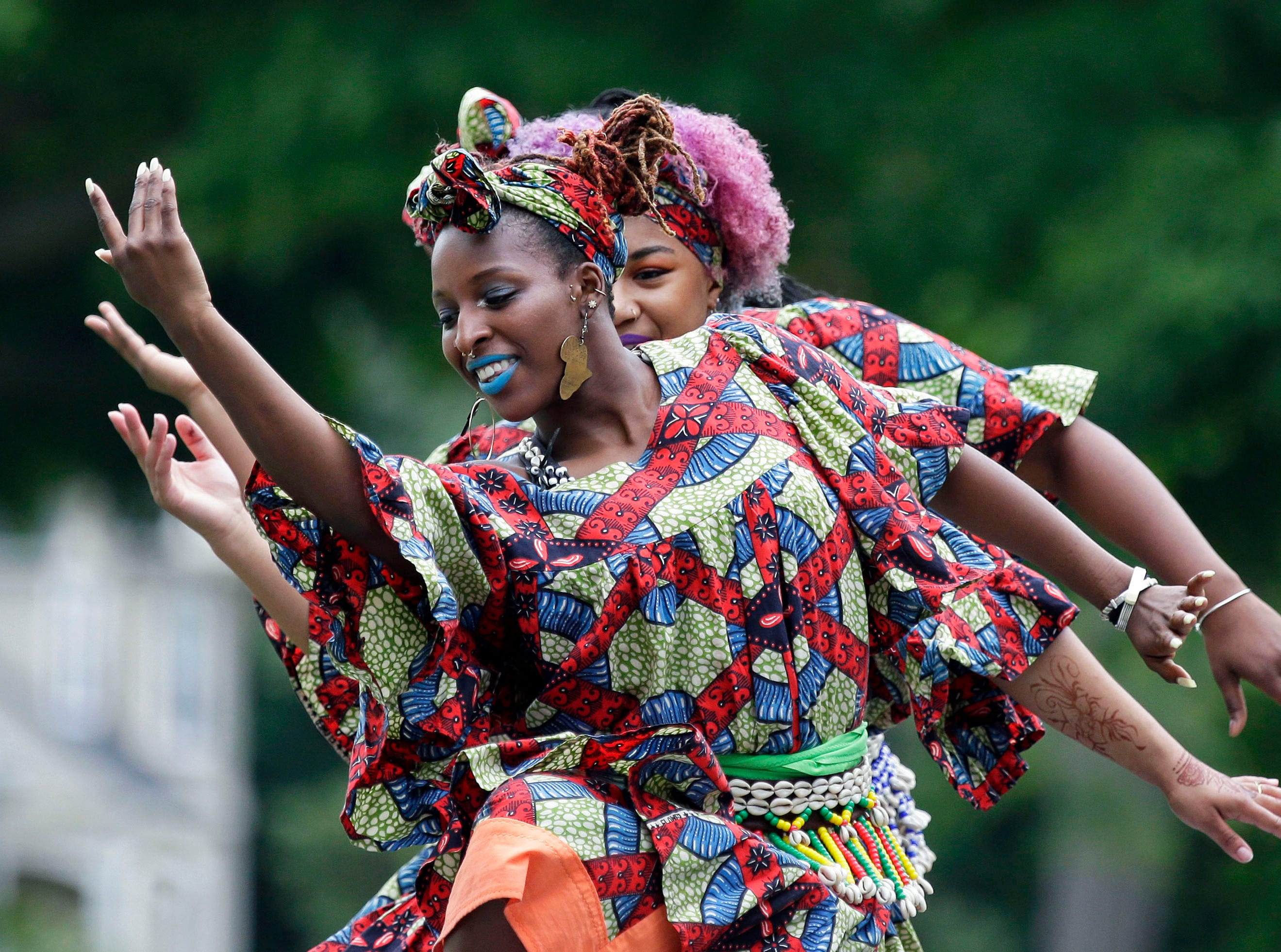 Members of the Muntu Dance Theatre of Chicago perform during the 2018 Juneteenth Festival Sunday, June 10, 2018, at City Park in Appleton, Wis.