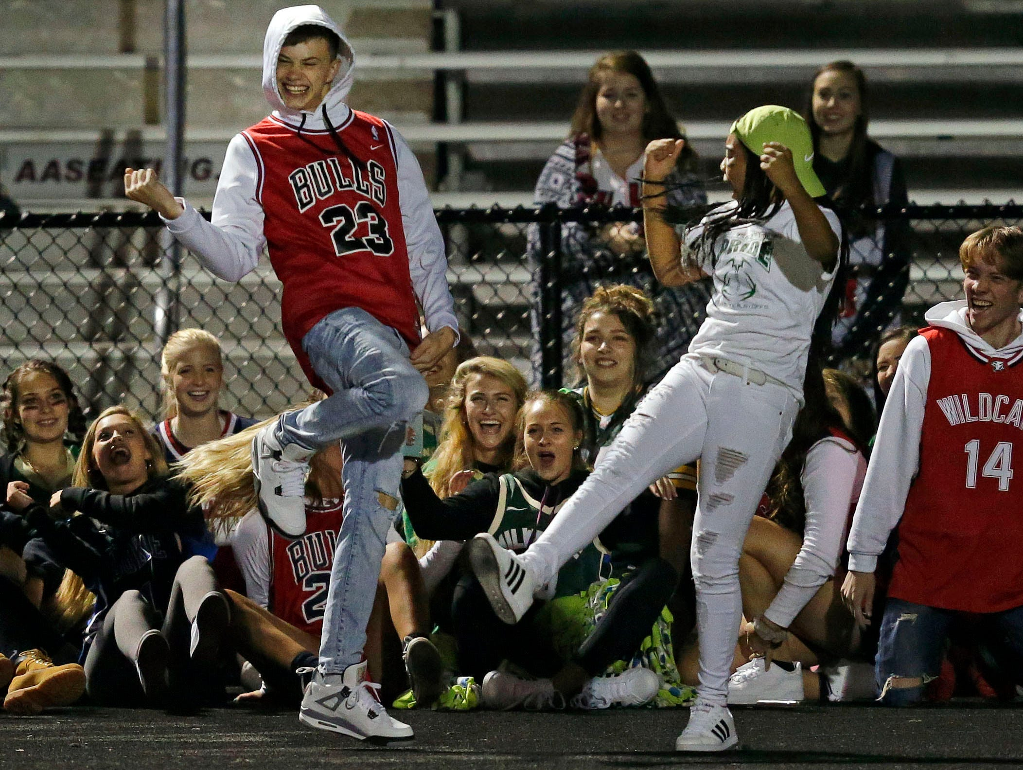 Student get in dance time at the half as Oshkosh North takes on Appleton West in a Valley Football Association game Friday, September 7, 2018, at Appleton West High School in Appleton, Wis.