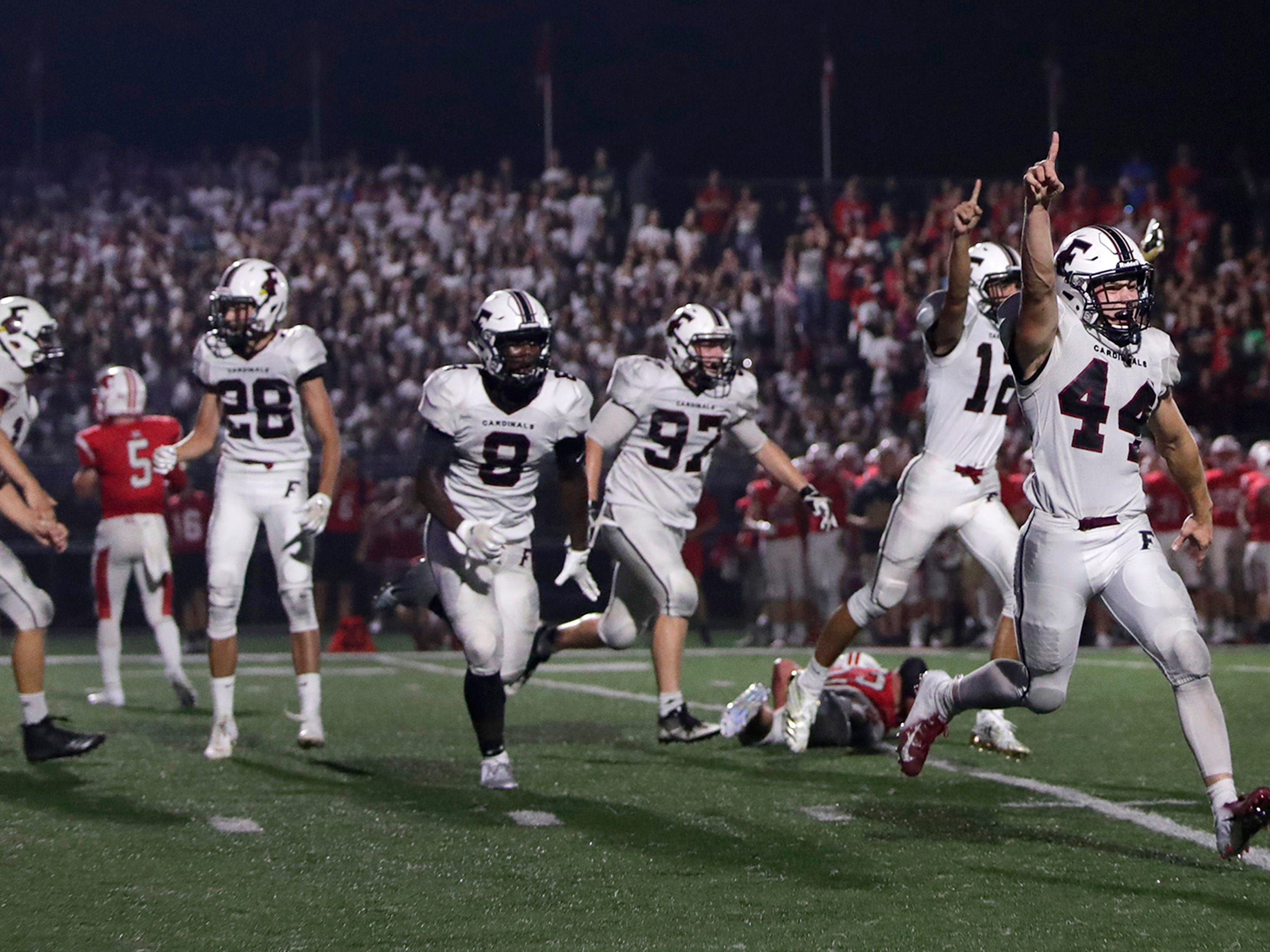 Players from Fond du Lac High School celebrate after winning their game against Kimberly High School 31-28 with a last second field goal Friday, Aug. 17, 2018, in Kimberly, Wis. Kimberly's loss ended their 70-game winning streak.