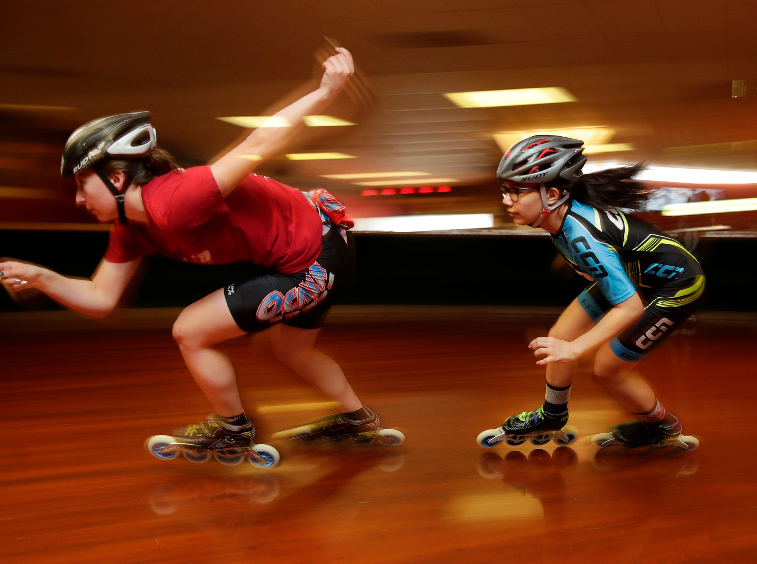 Miranda Halsey, 19, of Appleton, works on a two person corner blast with Cassie Gerdin, 12, of Appleton, while preparing for the 2018 USA Roller Sports Speed Skating National Championships Wednesday, July 11, 2018, at Skate City in Kimberly, Wis. 