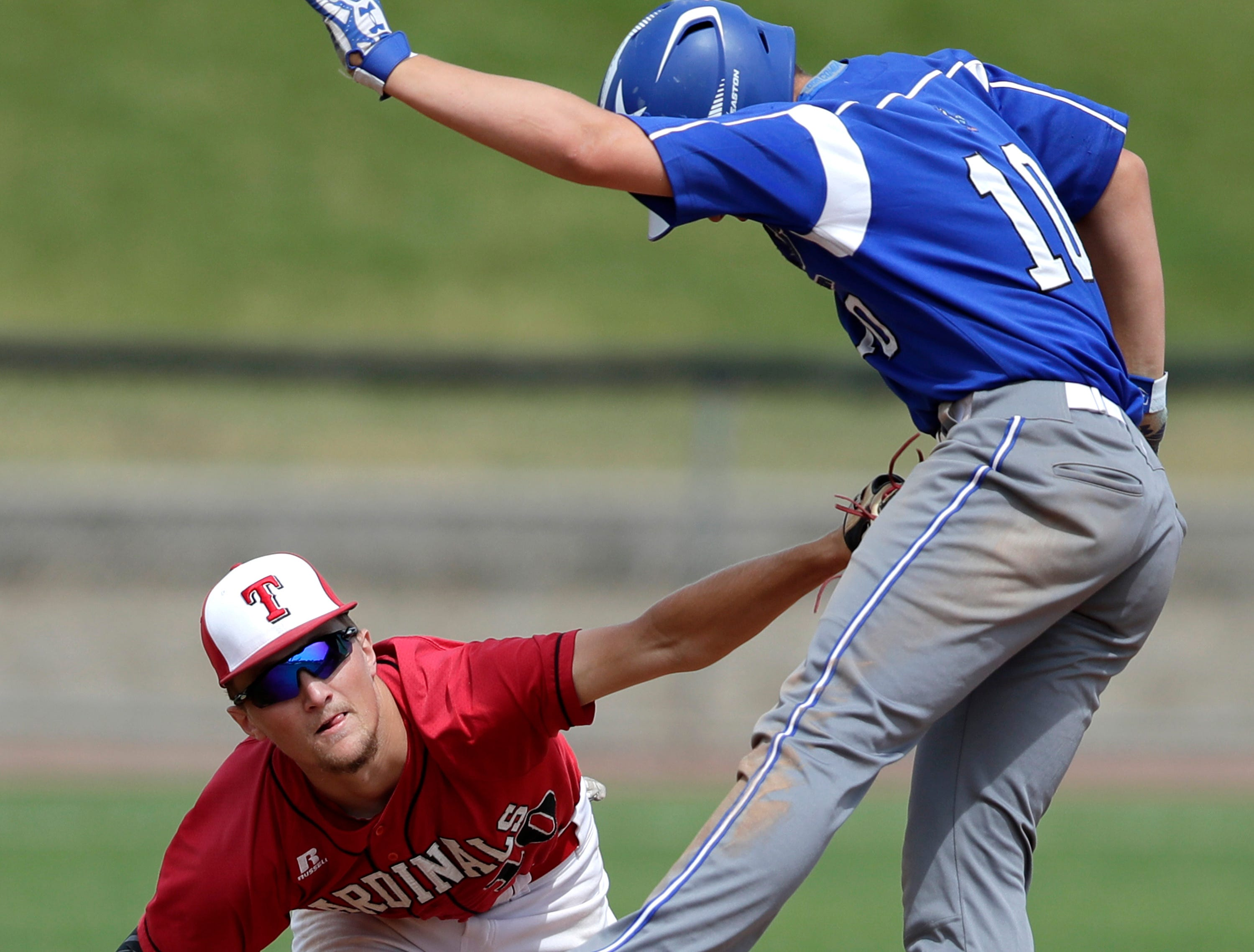 Athens High School's Dayne Diethelm is tagged at second base by Thorp High School's #10 Jakob Rosemeyer during their Division 4 championship game at the WIAA state spring baseball tournament on Thursday, June 14, 2018 at Neuroscience Group Field at Fox Cities Stadium in Grand Chute, Wis.  Athens defeated Thorp 13 to 10.