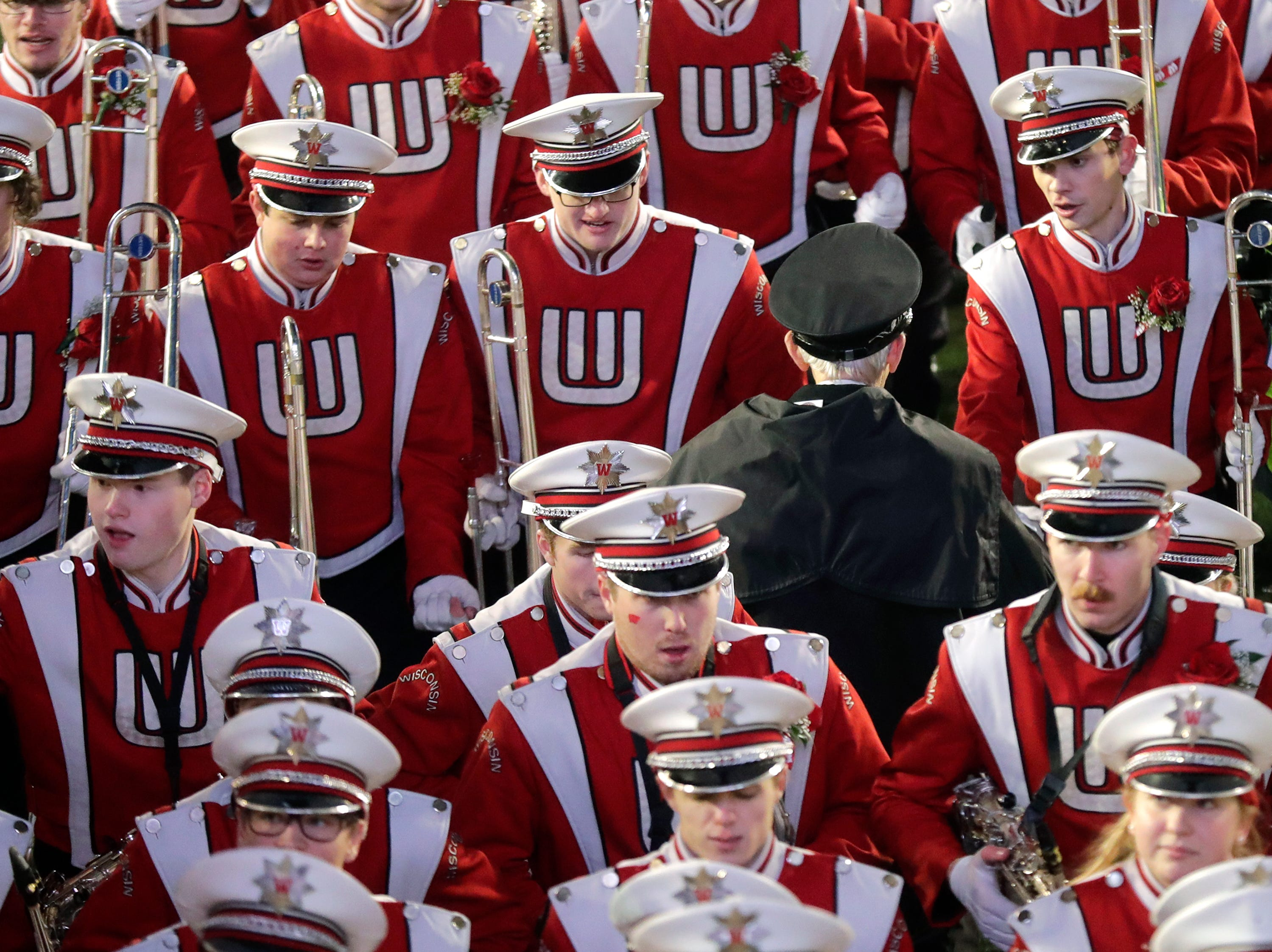 The University of Wisconsin Marching Band Director Michael Leckrone leaves the field following the Wisconsin Badgers loss to the Minnesota Gophers on Saturday, November 24, 2018, at Camp Randall in Madison, Wis. Leckrone is retiring after fifty years as leader of the band.