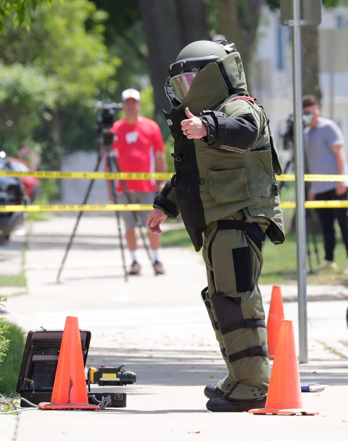 Srgt. John Schuette of the Outagamie County Sheriff's department gives a thumbs up securing a suspicious package that was discovered in front of the Outagamie County Administrative Building along South Walnut Street Tuesday, May 29, 2018, in Appleton, Wis. 