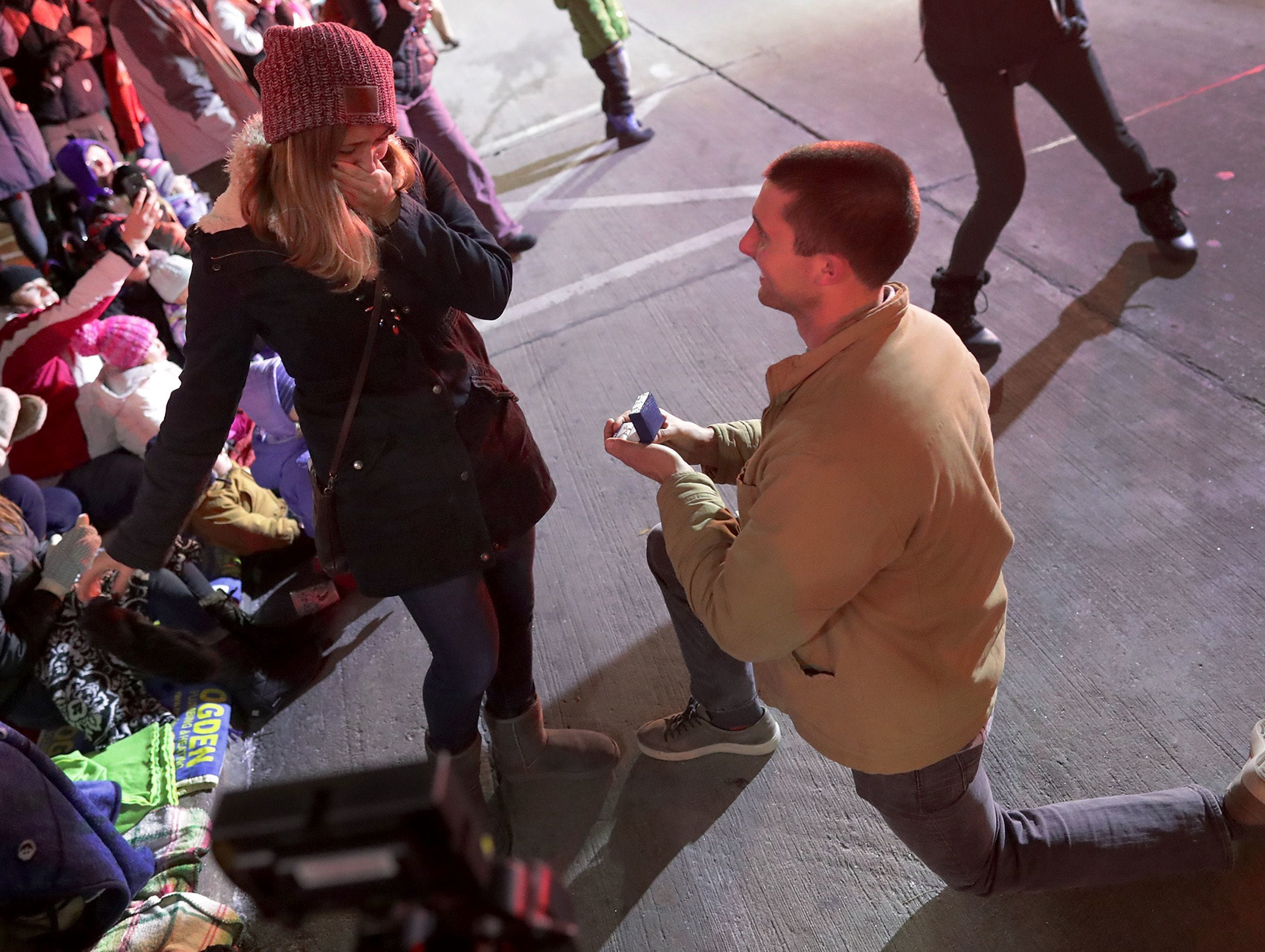 Appleton firefighter Bryce Sternhagen gets on one knee to propose to  teacher Samantha Cucci during Tuesday's Downtown Appleton Christmas Parade on Tuesday, Nov. 20, 2018 in Appleton, Wis.