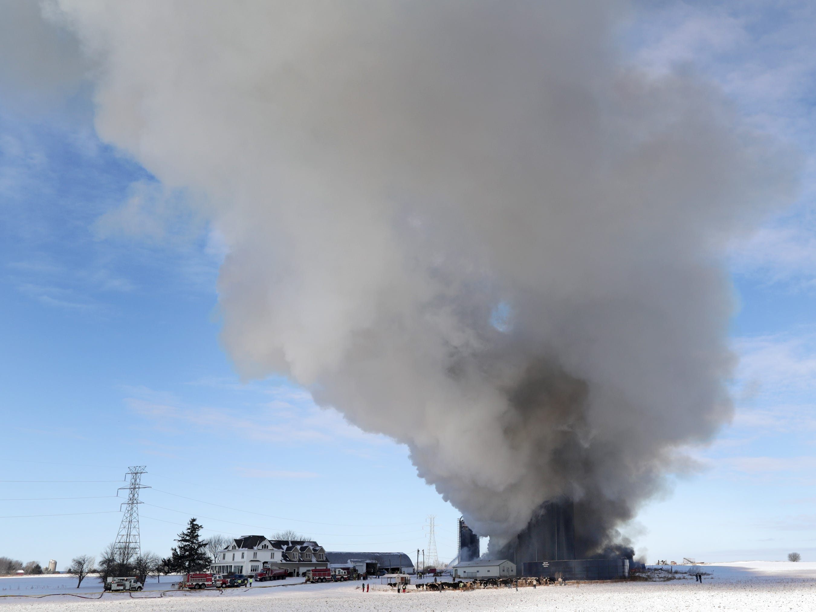 Firefighters respond to a structure fire at a farm on County JJ on Tuesday, January 16, 2018, in Ellington, Wis. 