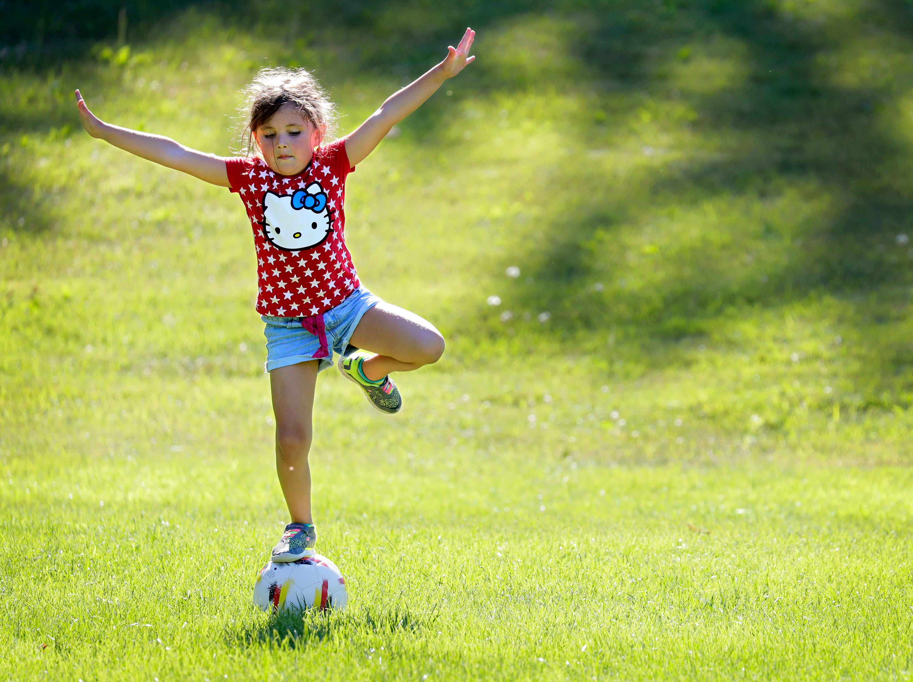 "Abigail Barnes, 6, of Kaukauna works on her unique soccer skills Friday, July 6, 2018, at the Don Fries Recreational Area in Combined Locks, Wis. ""I'm a daredevil. I'm superfast and do lots of crazy stuff,"" says Abigail. She was playing soccer with her brother Michael, 3, while her parents Monika and Joe Barnes were excercising in the same area.