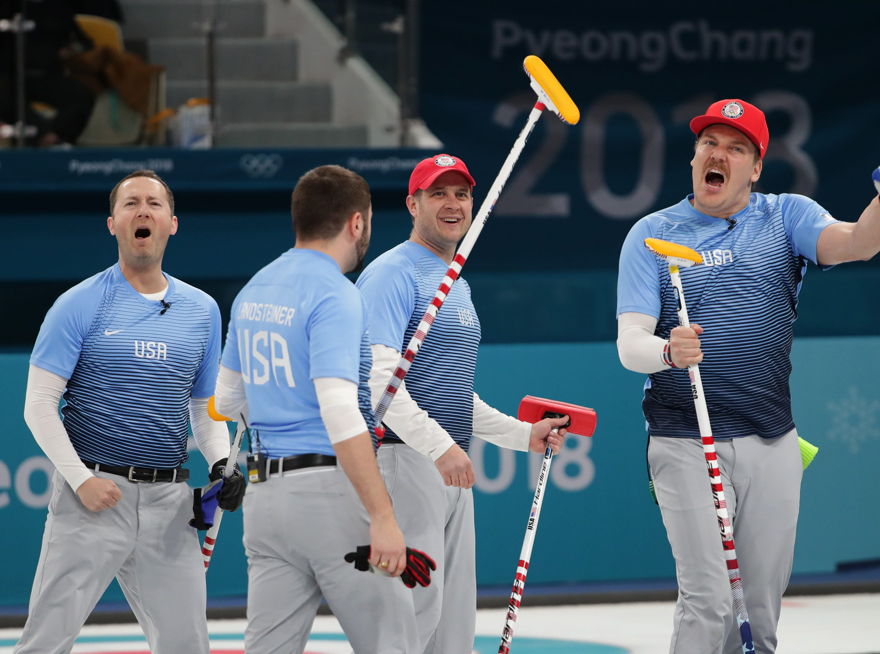 Feb 22, 2018; Gangneung, South Korea; Matt Hamilton (USA), far right, celebrates with teammates after beating Canada 5-3 in the Curling-Men Team Semifinal during the Pyeongchang 2018 Olympic Winter Games at Gangneung Curling Centre. Mandatory Credit: Dan Powers-USA TODAY Sports