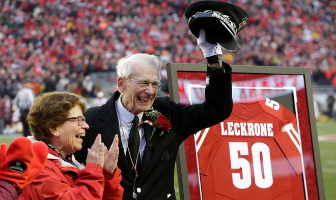 Retiring University of Wisconsin-Madison marching band director Michael Leckrone acknowledges the crowd after being presented with a jersey during the Badgers' final regular-season game.