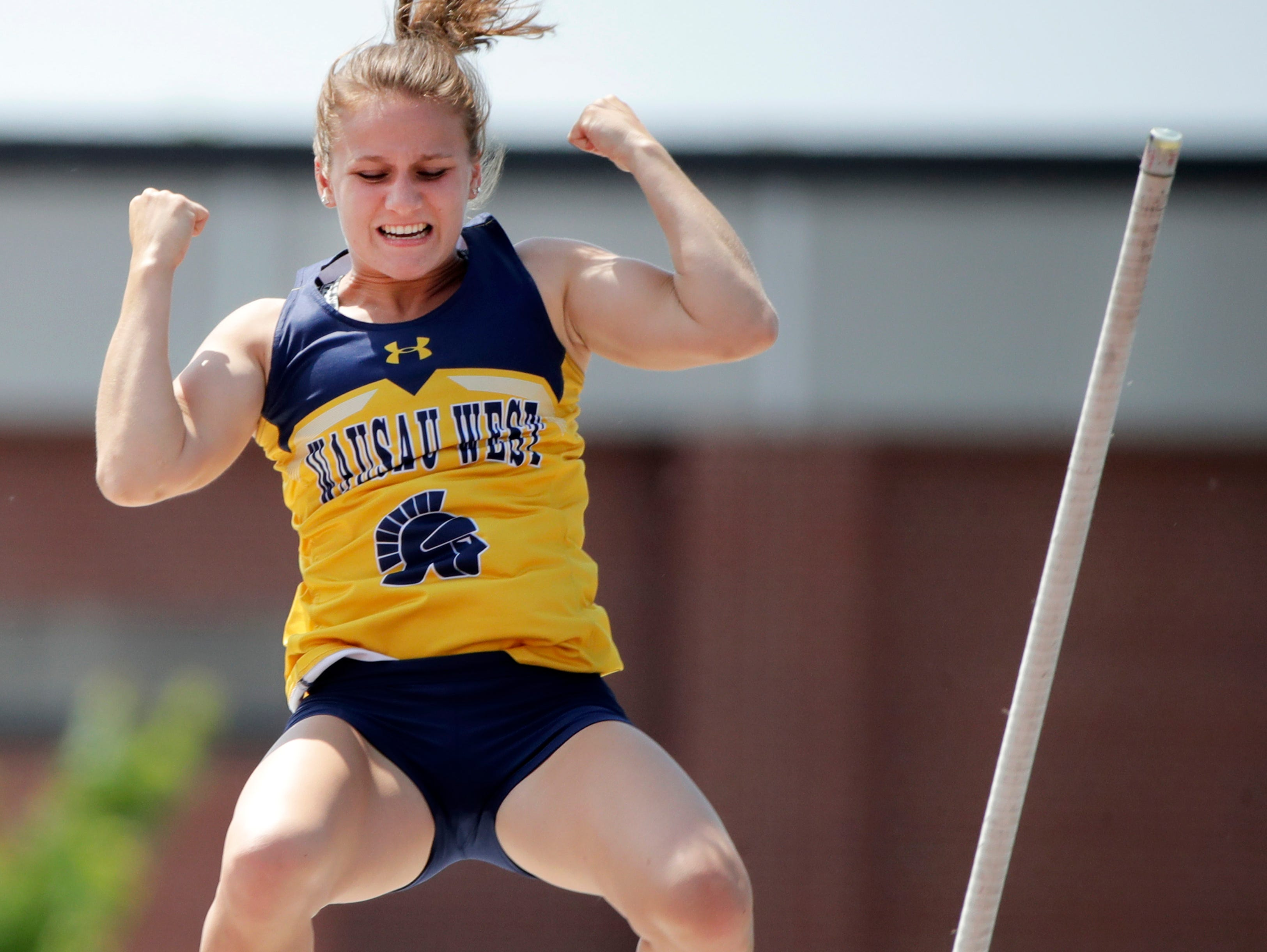 Wausau West's Olivia Bright celebrates in the air after clearing the bar in the Division 1 pole vault during the WIAA state track and field meet Friday, June 1, 2018, at Veterans Memorial Stadium in La Crosse, Wis. 