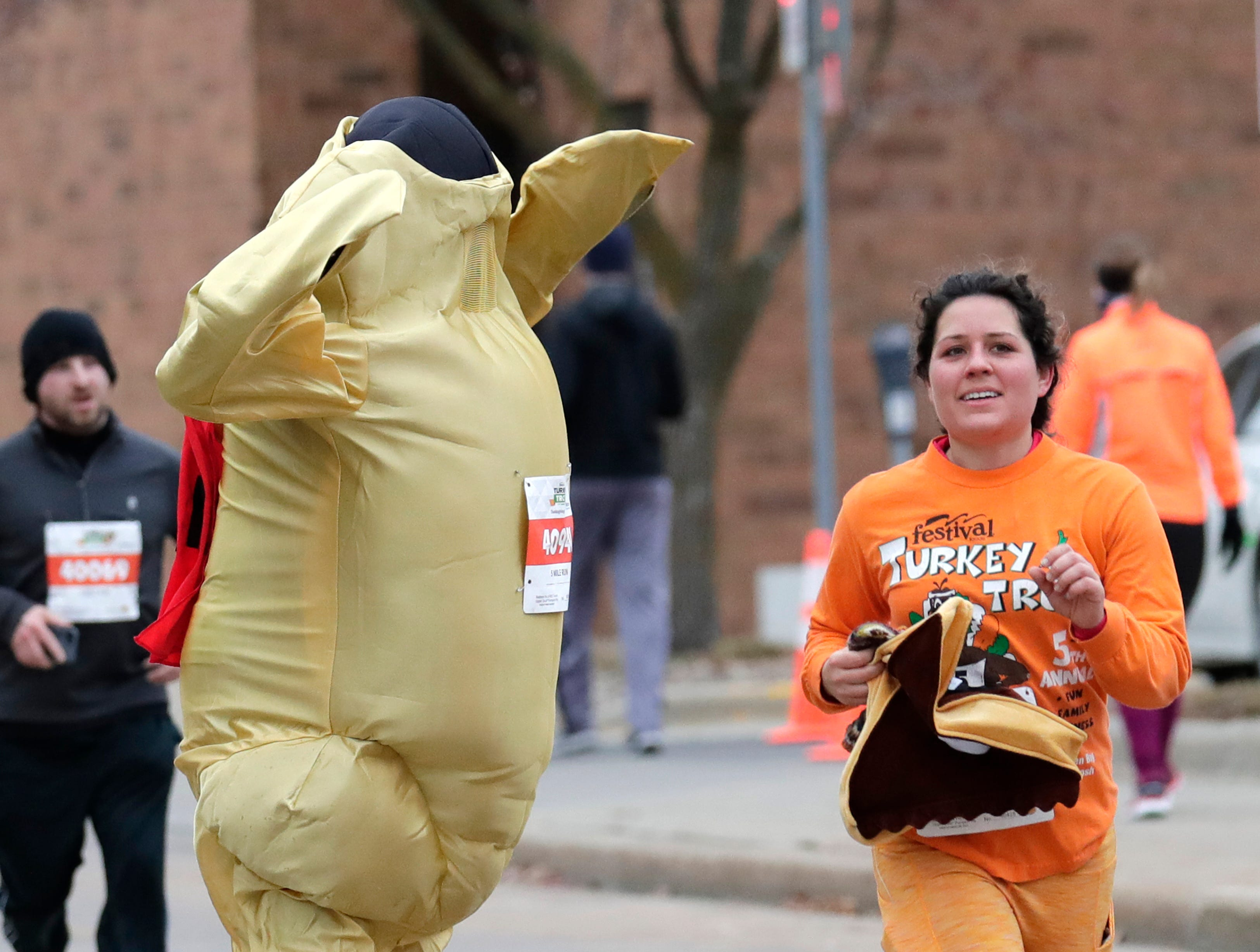 People participate in the 11th Annual Festival Foods Turkey Trot Thursday, November 22, 2018, in Appleton, Wis. 