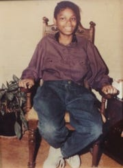 Photo of Quiana Dees taken at Christmas in 1991, five months before her death. The portrait hangs in the living room of her mother's home in Asbury Park.