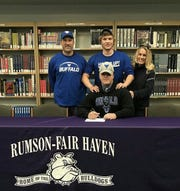 Rumson-Fair Haven long snapper Evan Davis (center) surrounded by his family is shown signing his national letter of intent to attend the University of Buffalo