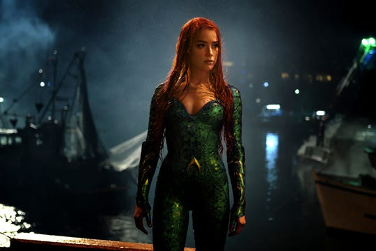 "This image released by Warner Bros. Pictures shows Amber Heard in a scene from ""Aquaman."" (via AP)"