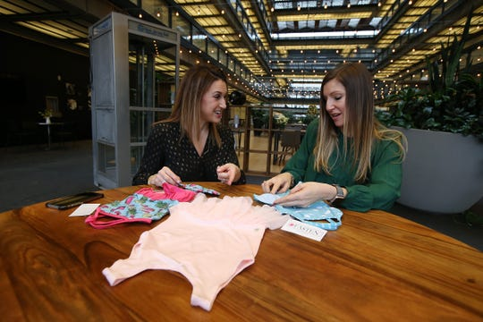 """Jill Slater and Alexis Castellano, co-owners of Fasten, a Marlboro-based maker of patented, easy-fastening bathing suits and leotards for """"girls on the go,"""" showcase their products at BellWorks in Holmdel, NJ Friday, December 21, 2018."""
