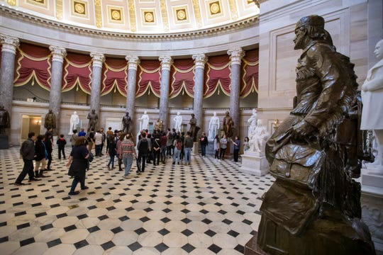 A public tour goes through Statuary Hall at the US Capitol in Washington, DC, USA, 21 December 2018. Congress and the President are attempting to avoid a partial government shutdown at midnight. Public tours would end if a shutdown occurs.