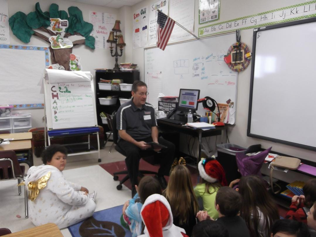 """David Robinett, sports director for Big Country Homepage, speaks to Bowie Elementary School students as part of the Altrusa International of Abilene's """"Reading Rodeo."""""""