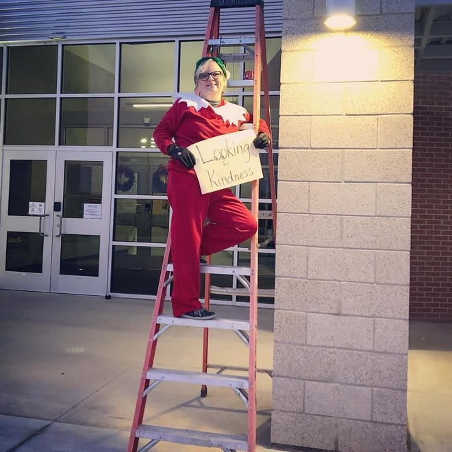 """Kim McMillan, principal of Wylie East Elementary School, dressed up as a kind version of the Elf on the Shelf for her students and teachers Tuesday/ McMillan, finding the experience """"addicting,"""" continued dressing up each morning for the rest of this past week, going to a new location for students to find during dropoff."""