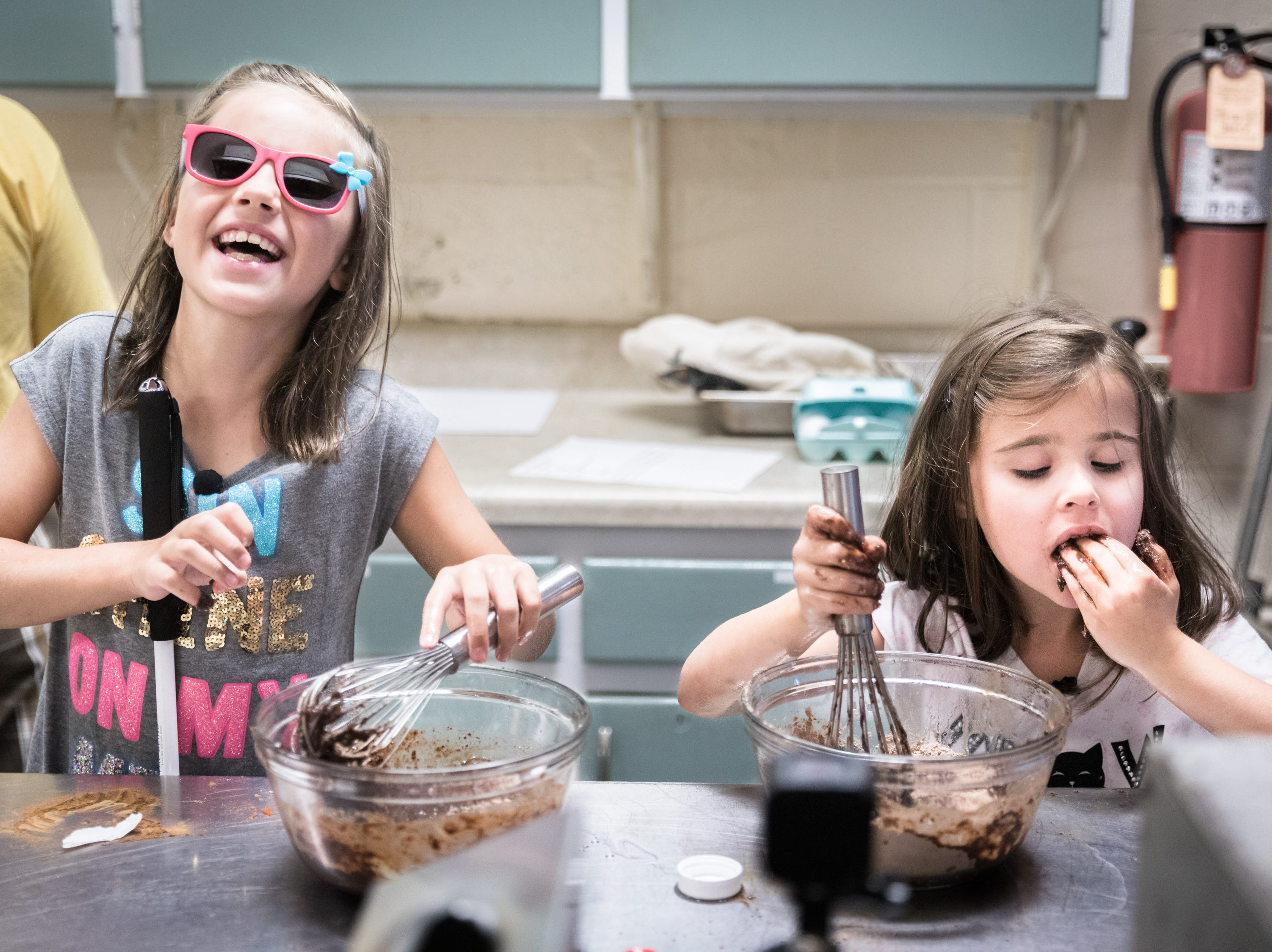 Layla Hildenbrand, 8, of Mills River, and Kyleigh Adkins, 6, of Hickory, both campers at SEE day camp for children with visual impairment provided by IFB Solutions, mix brownie batter as they prepare a lunch for the campers' parents at Grace Baptist Church in West Asheville, Thursday, July 12, 2018. The camp, which is supported by IFB Solutions and sponsors, is free of charge for campers and took place from July 9 to July 13.