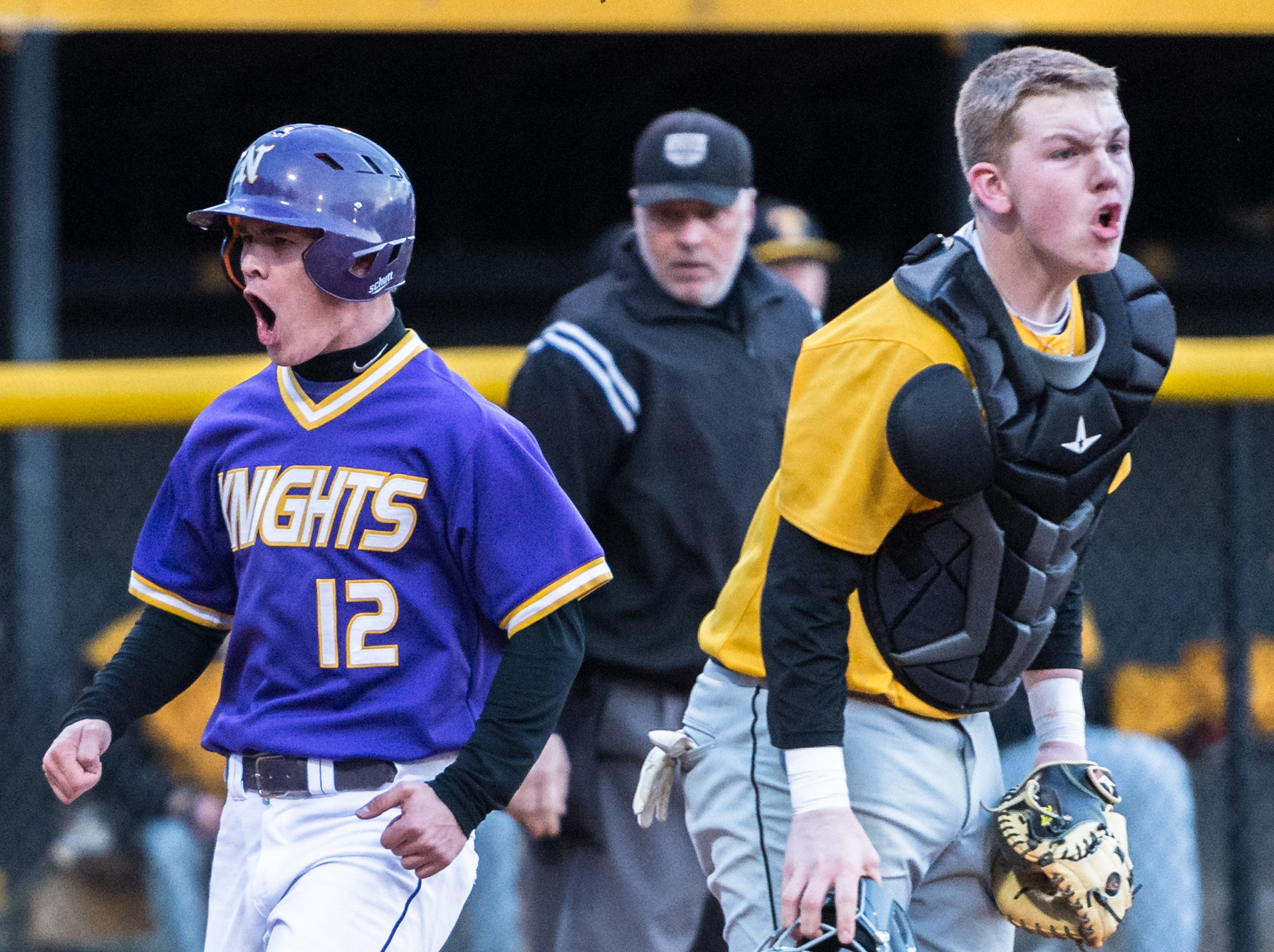 North Henderson's Kyle Decker cheers as he safely crosses home plate during their game against Tuscola Friday, March 9, 2018. North Henderson defeated Tuscola 5-2 in 11 innings.