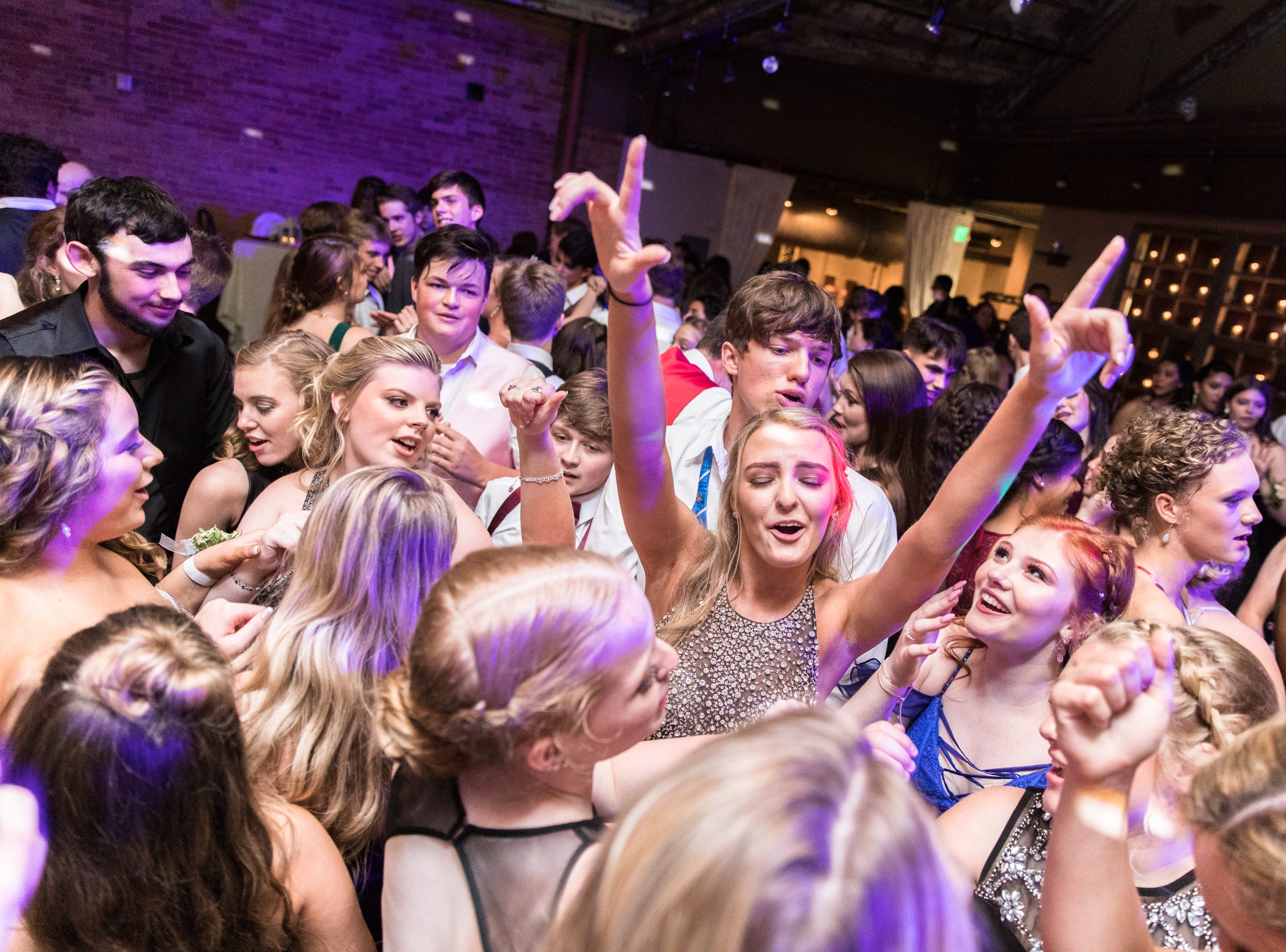 Owen High School students gathered in downtown Asheville Friday May 18, 2018, for their prom with the theme Once Upon a Time, at The Venue on Market Street.