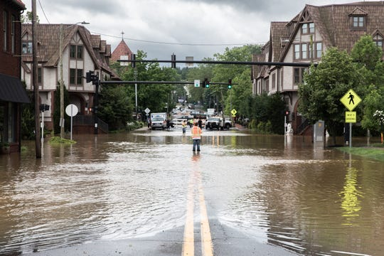 Biltmore Avenue, completely flooded Wednesday, May 30, 2018 as a result of heavy rain throughout Western North Carolina.