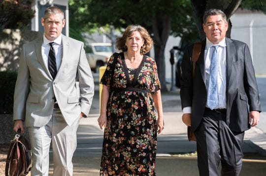 Wanda Greene, former Buncombe County Manager, walks to the federal courthouse with her attorneys Thomas Amburgey and Noell Tin, Wednesday, June 13, 2018, to appear before a U.S magistrate judge where she will be indicted on additional charges of using public money to buy life insurance policies for herself and other employees. Greene was indicted in April on charges of wire fraud, conspiracy, embezzlement and aiding and abetting.