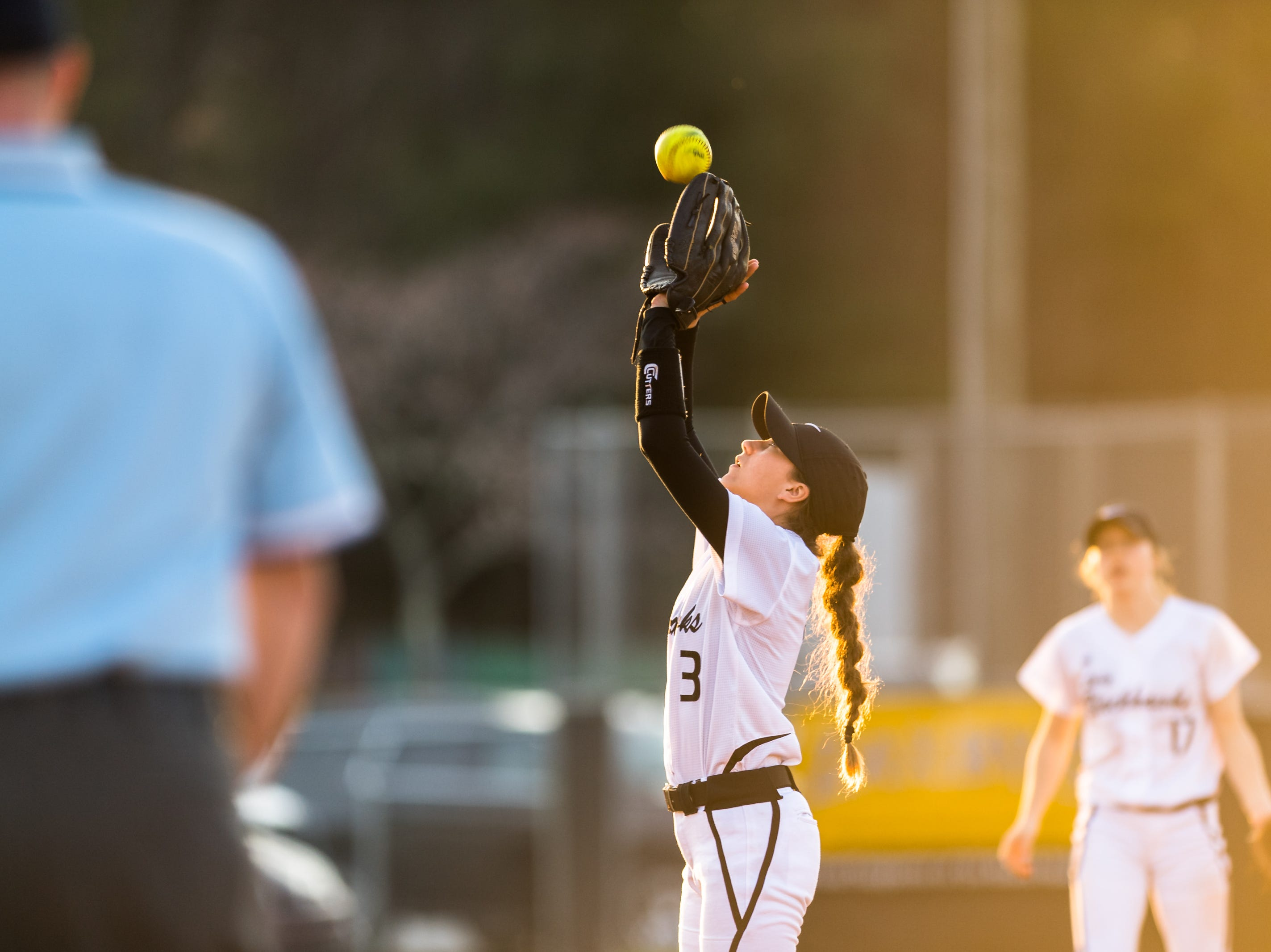 North Buncombe's Abigail Cook makes a catch for an out during their game against Reynolds Friday, March 16, 2018. North Buncombe defeated Reynolds 2-0 in seven innings.