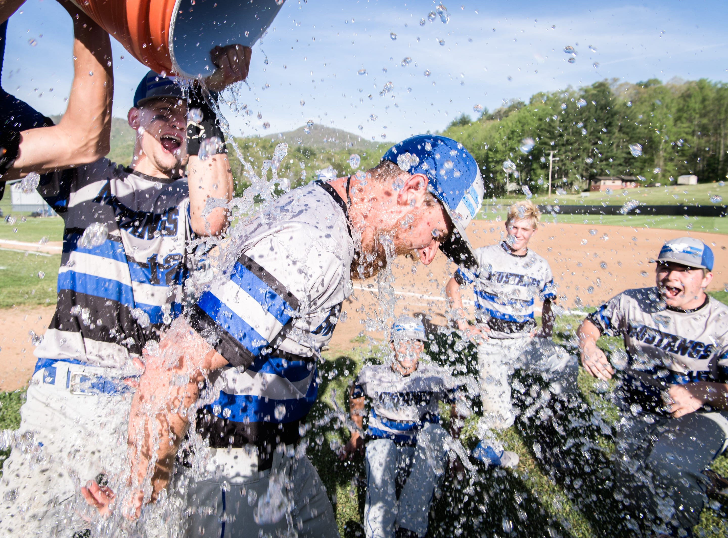 Smoky Mountain baseball coach Jeremy Ellenburg is doused with water after their 7-2 win over Franklin, Thursday, May 3, 2018.