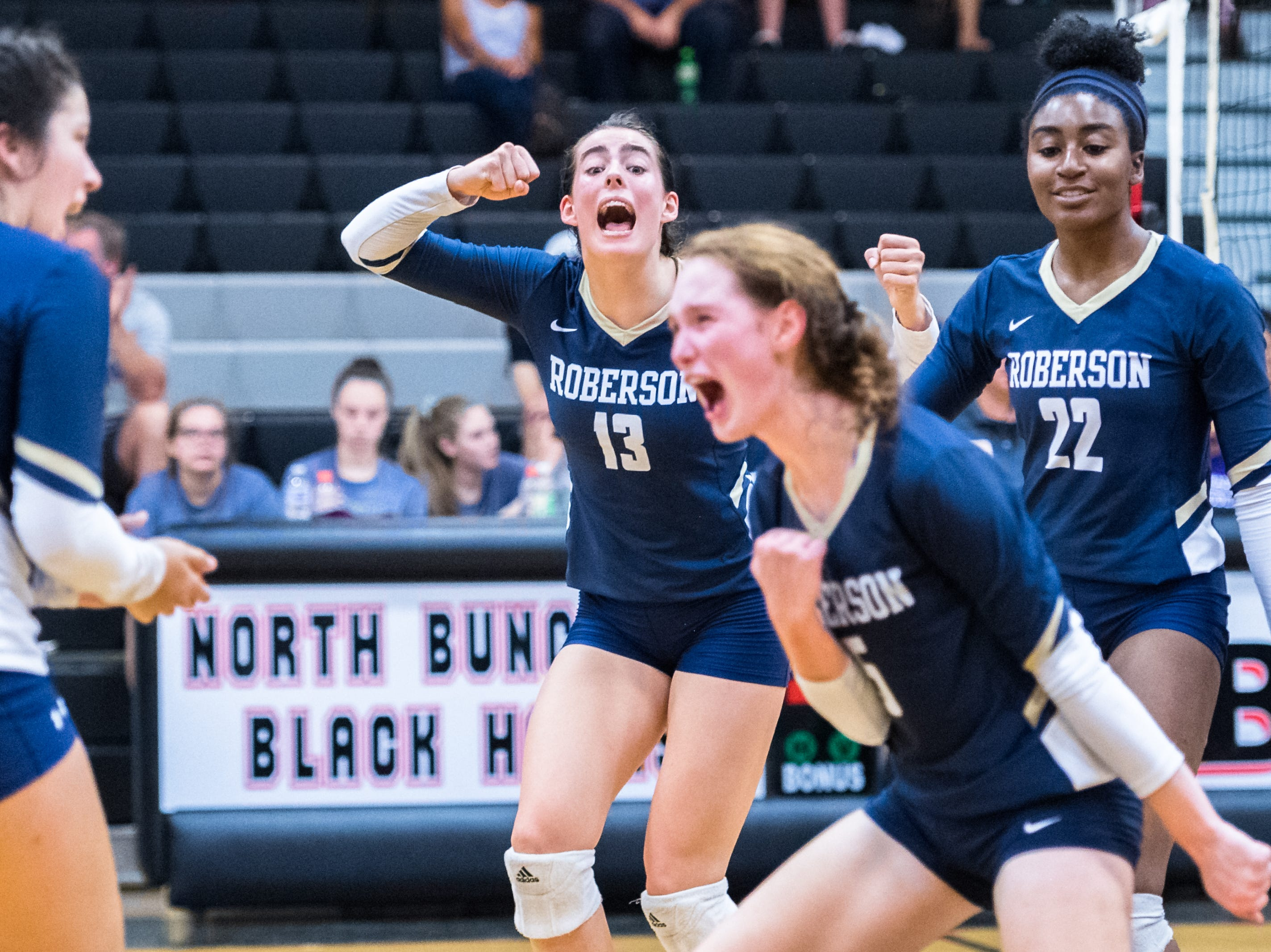 Roberson's Isabella Field, Simone Tezzo and  Amy Webster celebrate during their game against North Buncombe, Aug. 21, 2018.