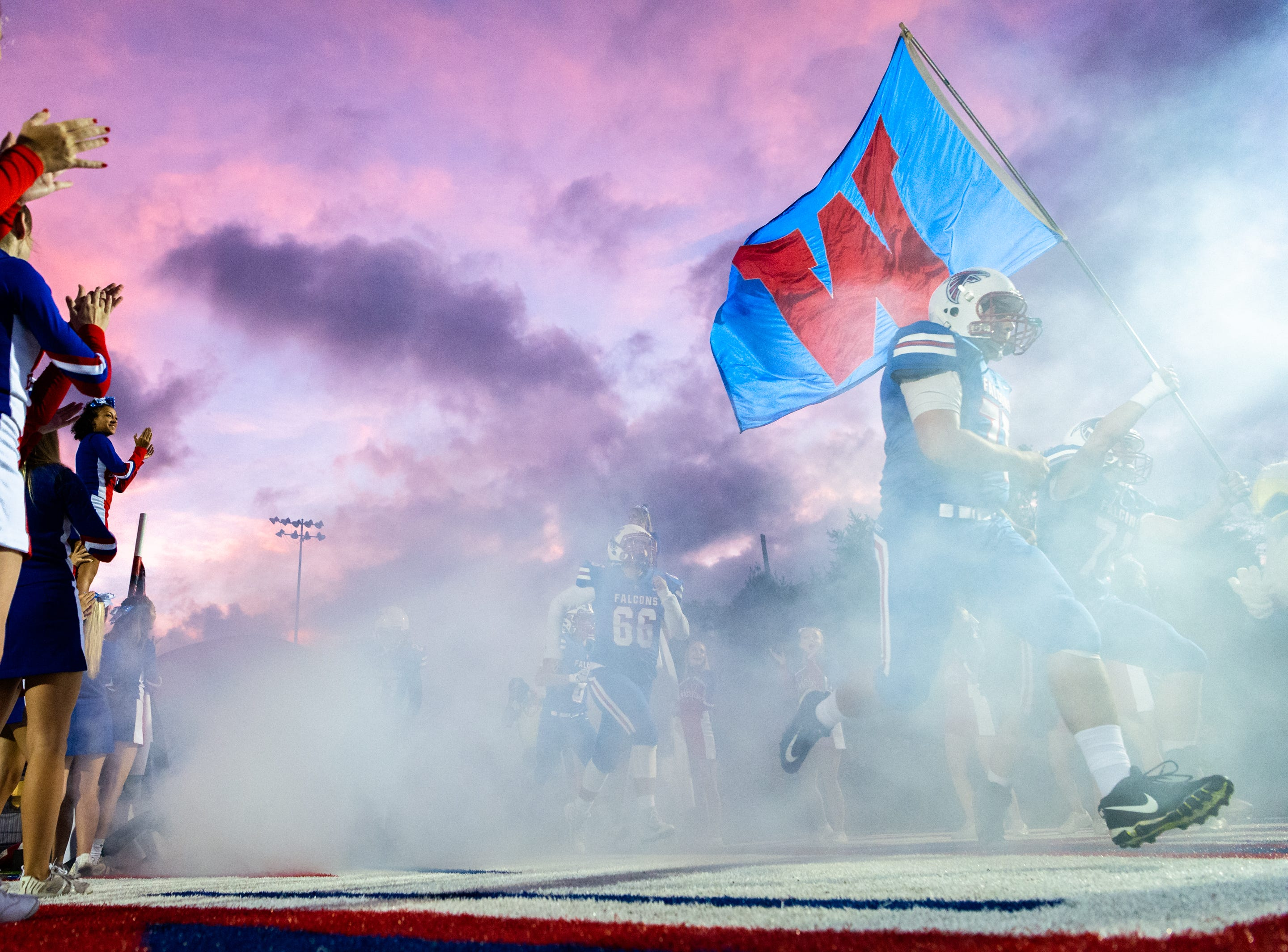 The West Henderson football team runs onto the field before their Friday night game against Erwin Sept. 28, 2018. Erwin won 55-33.