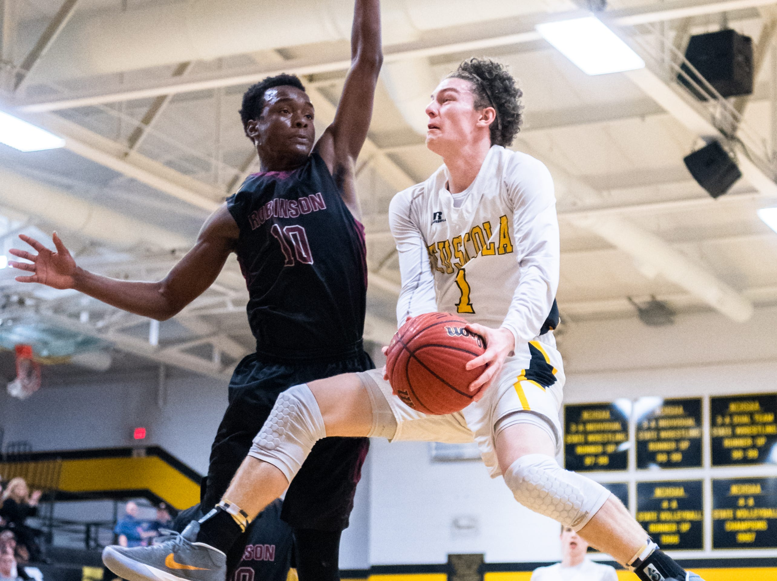 The Tuscola boys basketball team played Jay Robinson in the first round of playoffs losing 76-75, Tuesday, February 20, 2018.