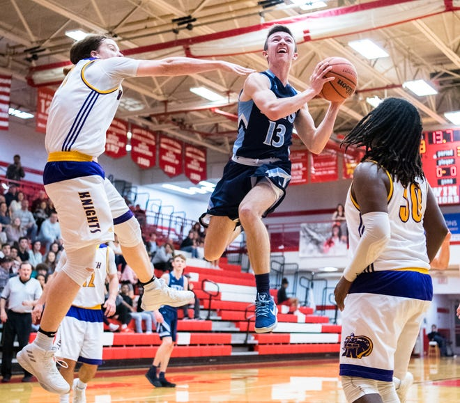 North Henderson and Enka boys basketball teams competed in the WMAC conference tournament game at Erwin high school, Monday, February 12, 2018.