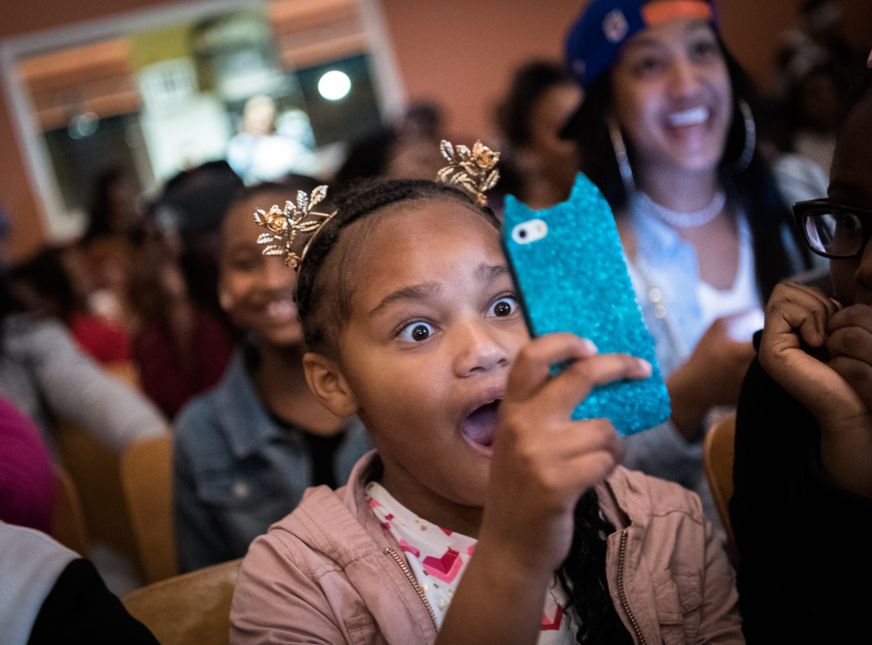Johanna Jeter, 8, reacts to a performance at the fourth Asheville Urban Youth talent show held at the Dr. Wesley Grant Sr. Southside Center Saturday, April 7, 2018.