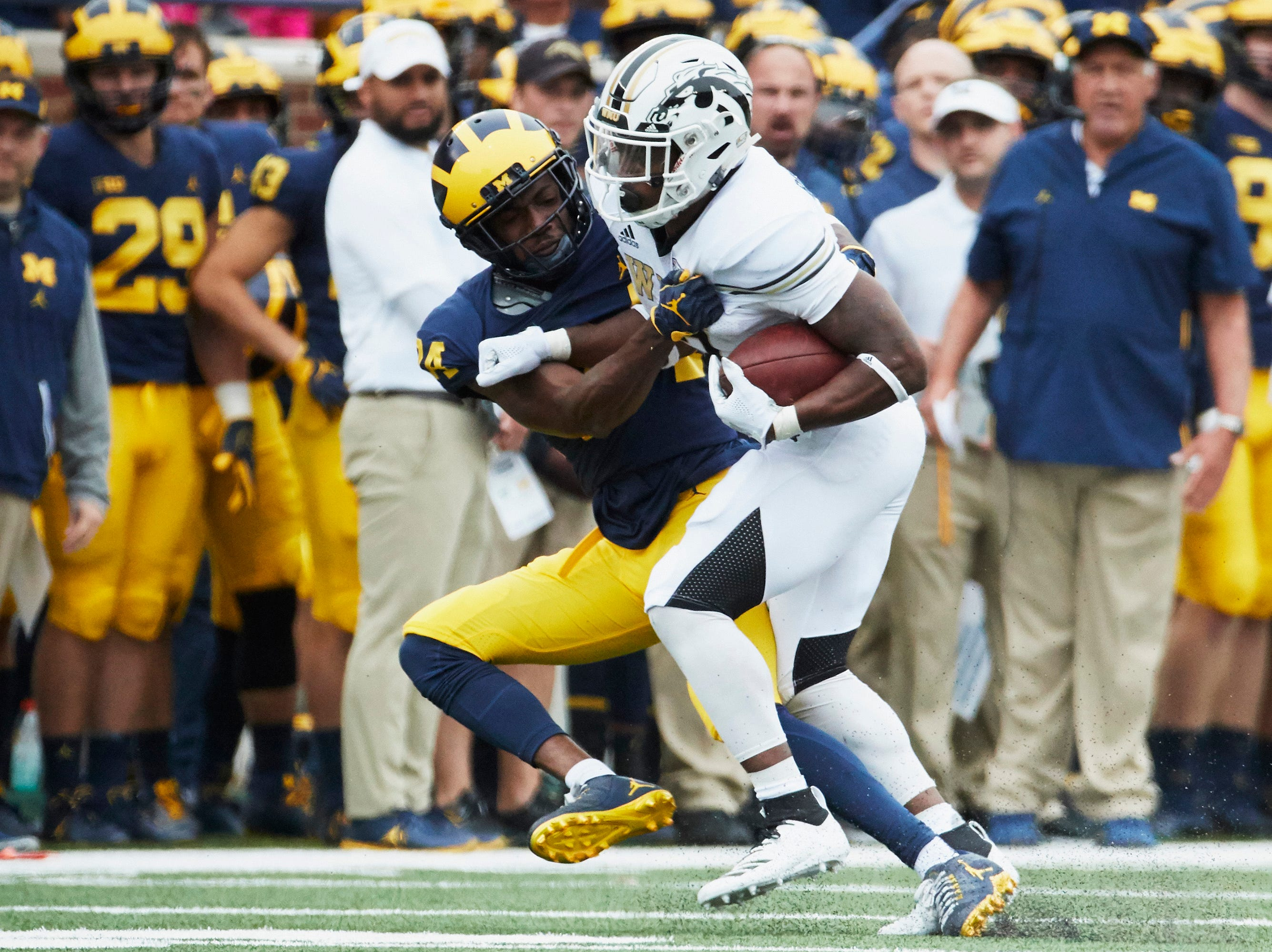 Sep 8, 2018; Ann Arbor, MI, USA; Western Michigan Broncos running back LeVante Bellamy (2) is tackled by Michigan Wolverines defensive back Lavert Hill (24) in the first half at Michigan Stadium. Mandatory Credit: Rick Osentoski-USA TODAY Sports