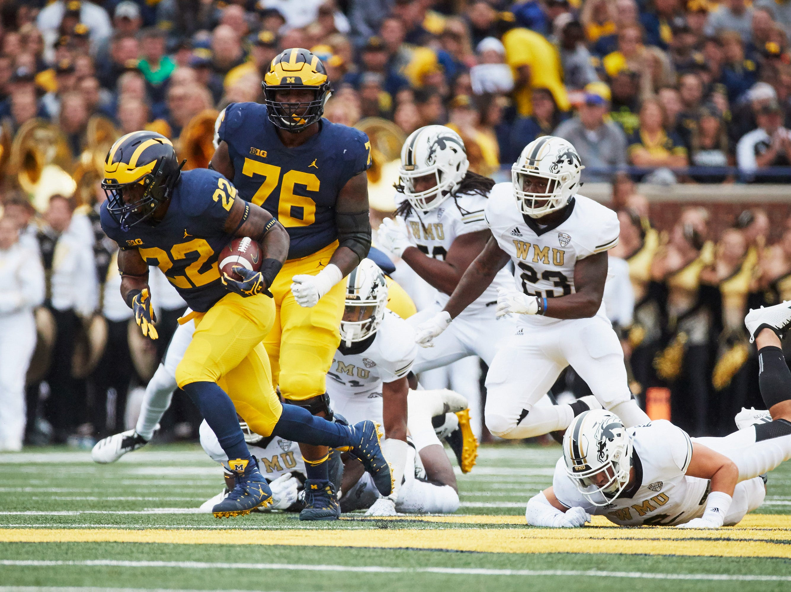 Sep 8, 2018; Ann Arbor, MI, USA; Michigan Wolverines running back Karan Higdon (22) rushes in the first half against the Western Michigan Broncos at Michigan Stadium. Mandatory Credit: Rick Osentoski-USA TODAY Sports