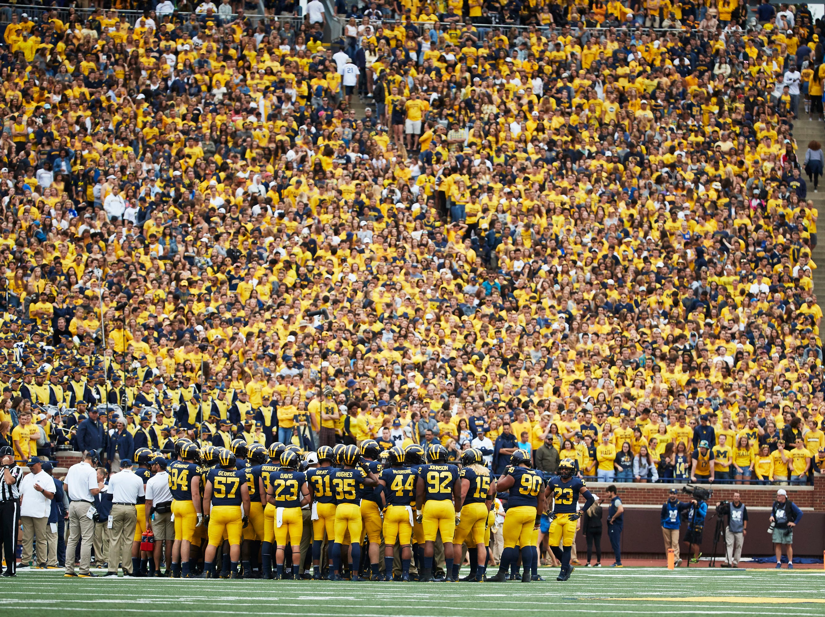 Sep 8, 2018; Ann Arbor, MI, USA; Michigan Wolverines players huddle up during a time out in the second half against the Western Michigan Broncos at Michigan Stadium. Mandatory Credit: Rick Osentoski-USA TODAY Sports