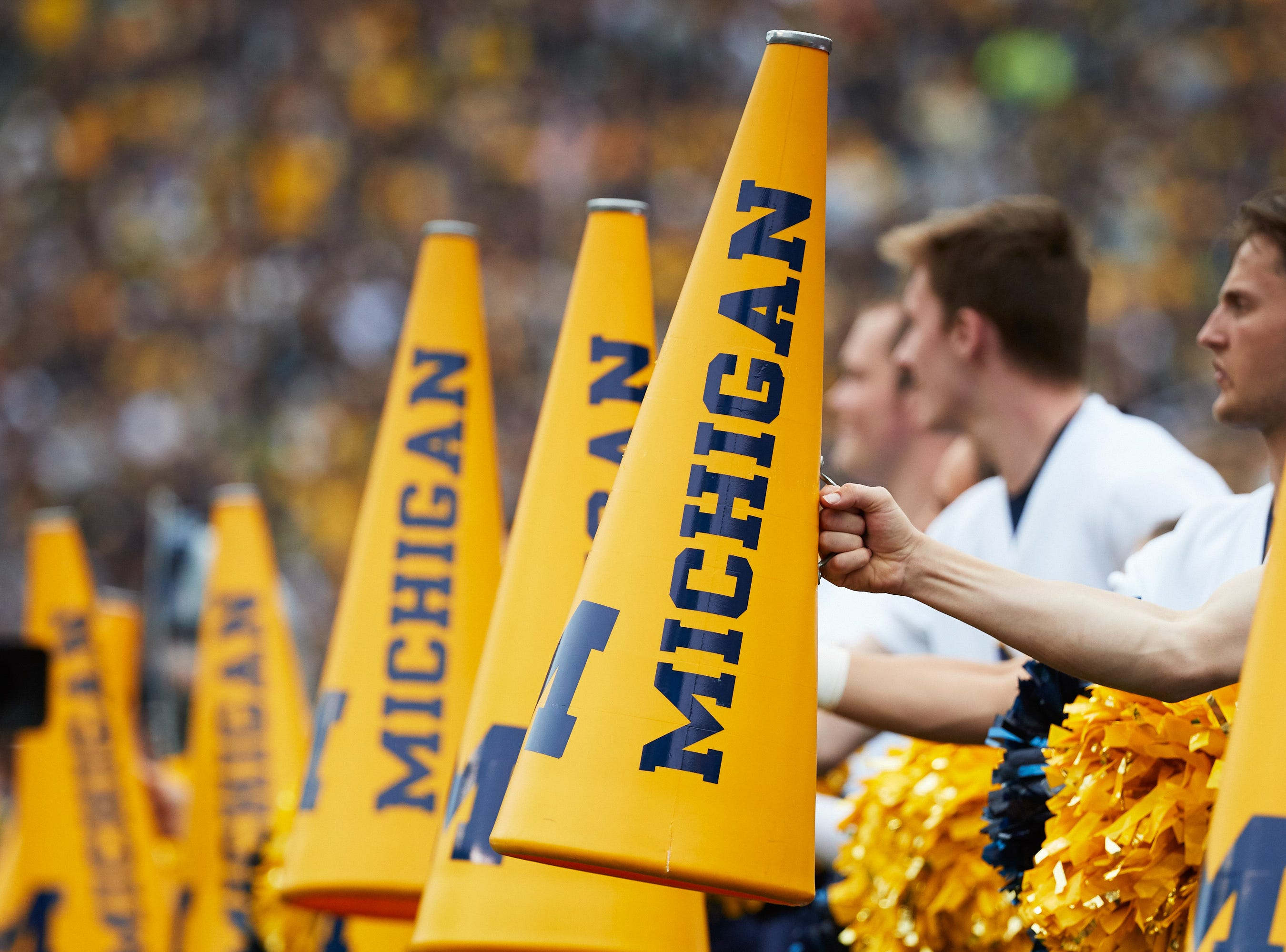 Sep 8, 2018; Ann Arbor, MI, USA; Michigan Wolverines cheerleader megaphones at Michigan Stadium. Mandatory Credit: Rick Osentoski-USA TODAY Sports