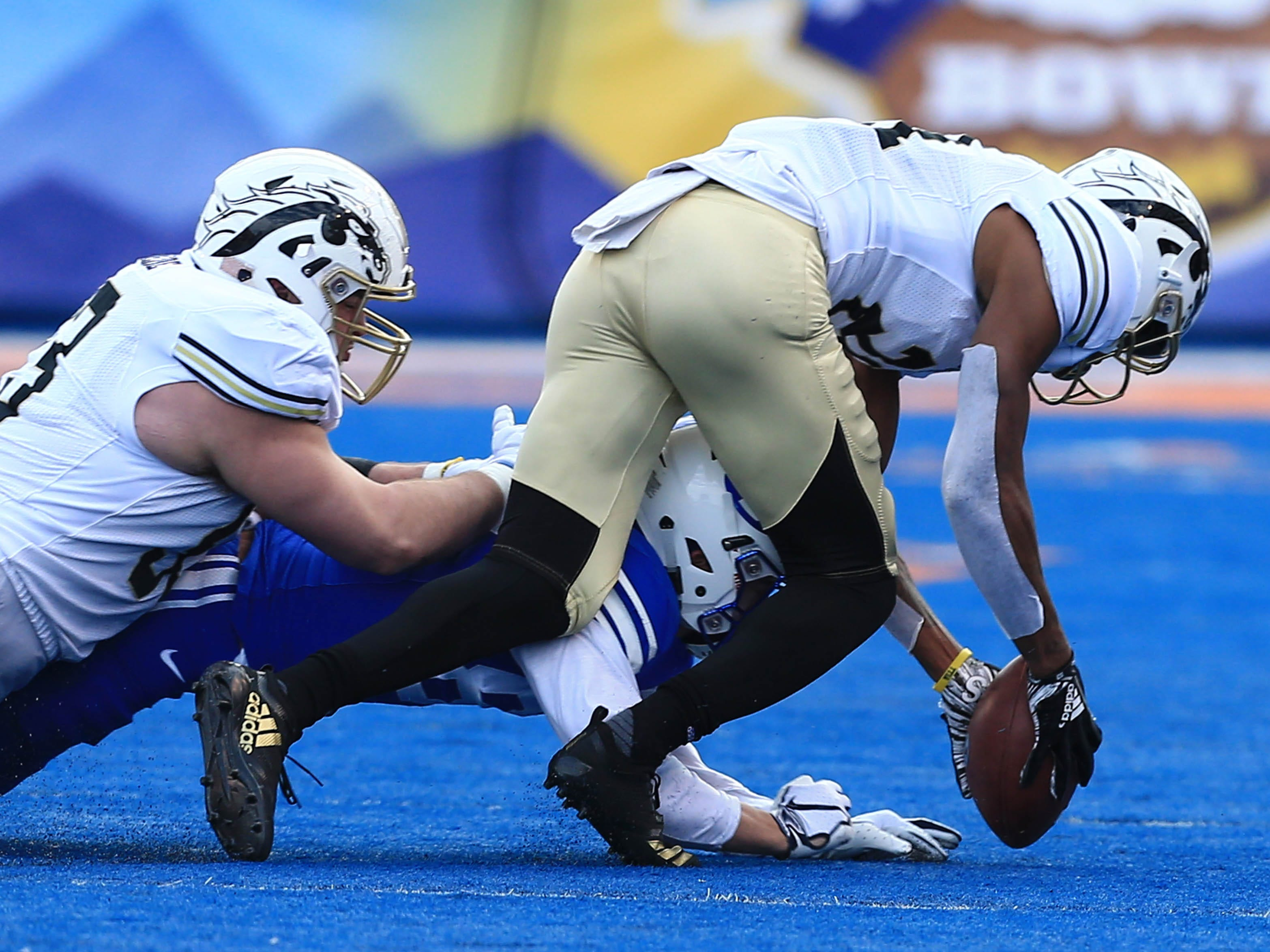 Dec 21, 2018; Boise, ID, United States; Western Michigan Broncos defensive back Stefan Claiborne (21) recovers a fumble during the first half against the Brigham Young Cougars during the  2018 Potato Bowl at Albertsons Stadium.
