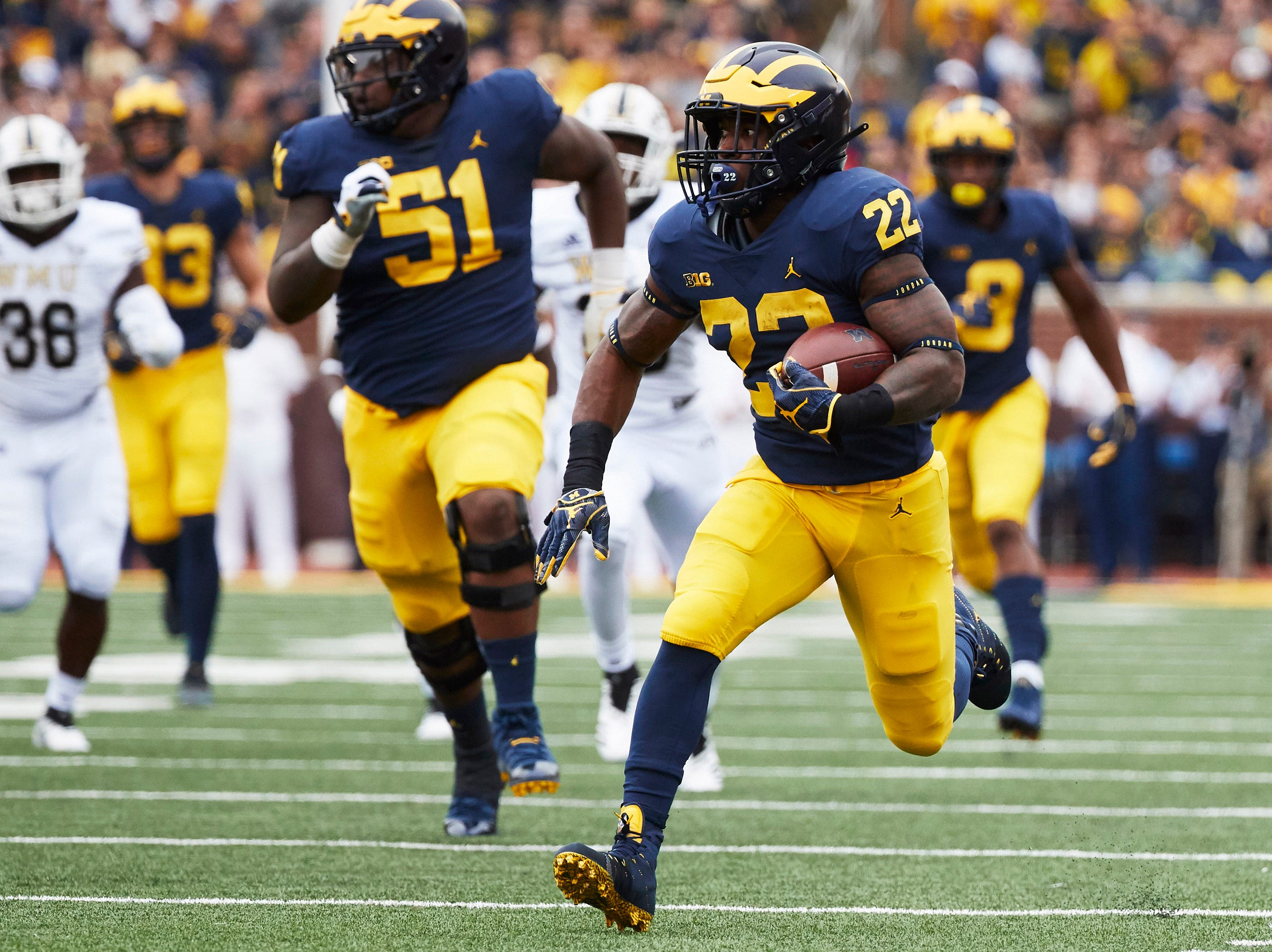 Sep 8, 2018; Ann Arbor, MI, USA; Michigan Wolverines running back Karan Higdon (22) rushes for a touchdown in the first half against the Western Michigan Broncos at Michigan Stadium. Mandatory Credit: Rick Osentoski-USA TODAY Sports