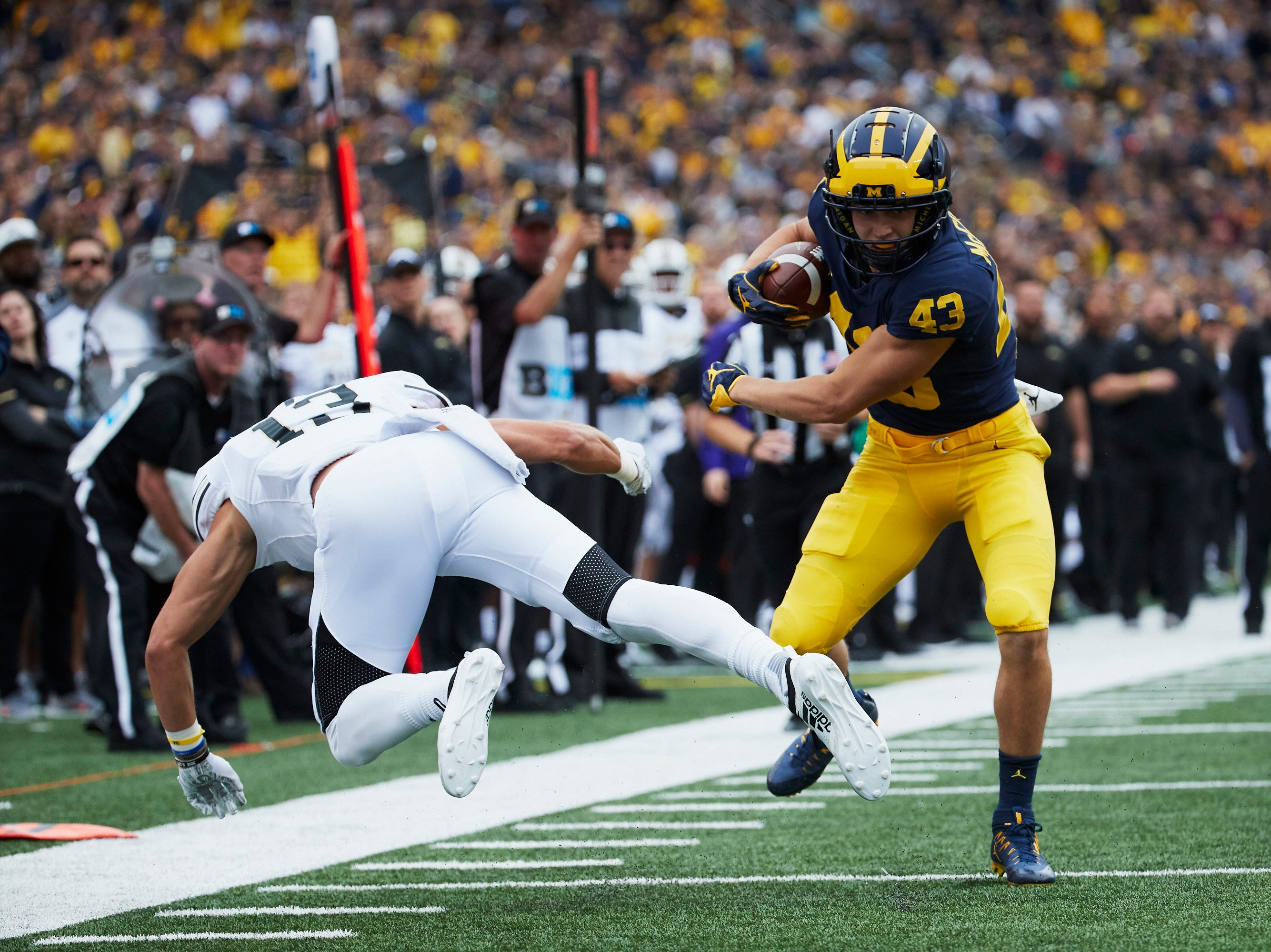 Sep 8, 2018; Ann Arbor, MI, USA; Michigan Wolverines wide receiver Jake McCurry (43) makes Western Michigan Broncos defensive back Harrison Taylor (13) miss a tackle as he runs for a touchdown in the second half at Michigan Stadium. Mandatory Credit: Rick Osentoski-USA TODAY Sports